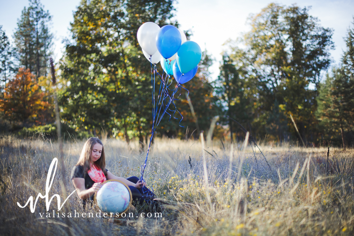 Senior with Balloons and a Globe
