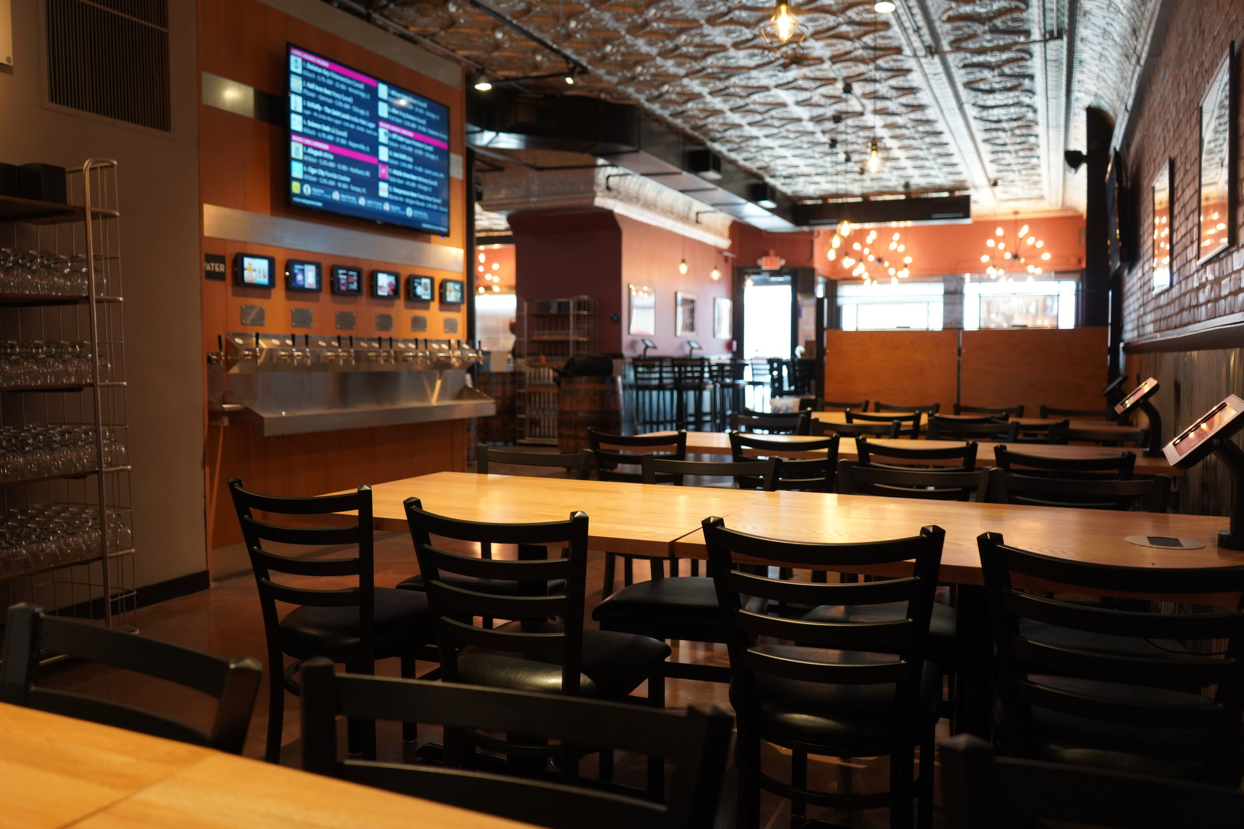 Lager Row - Four low-top communal tables, plus standing space. Accommodates up to 34 people comfortably. Located directly in front of the Pour Your Own beer wall!