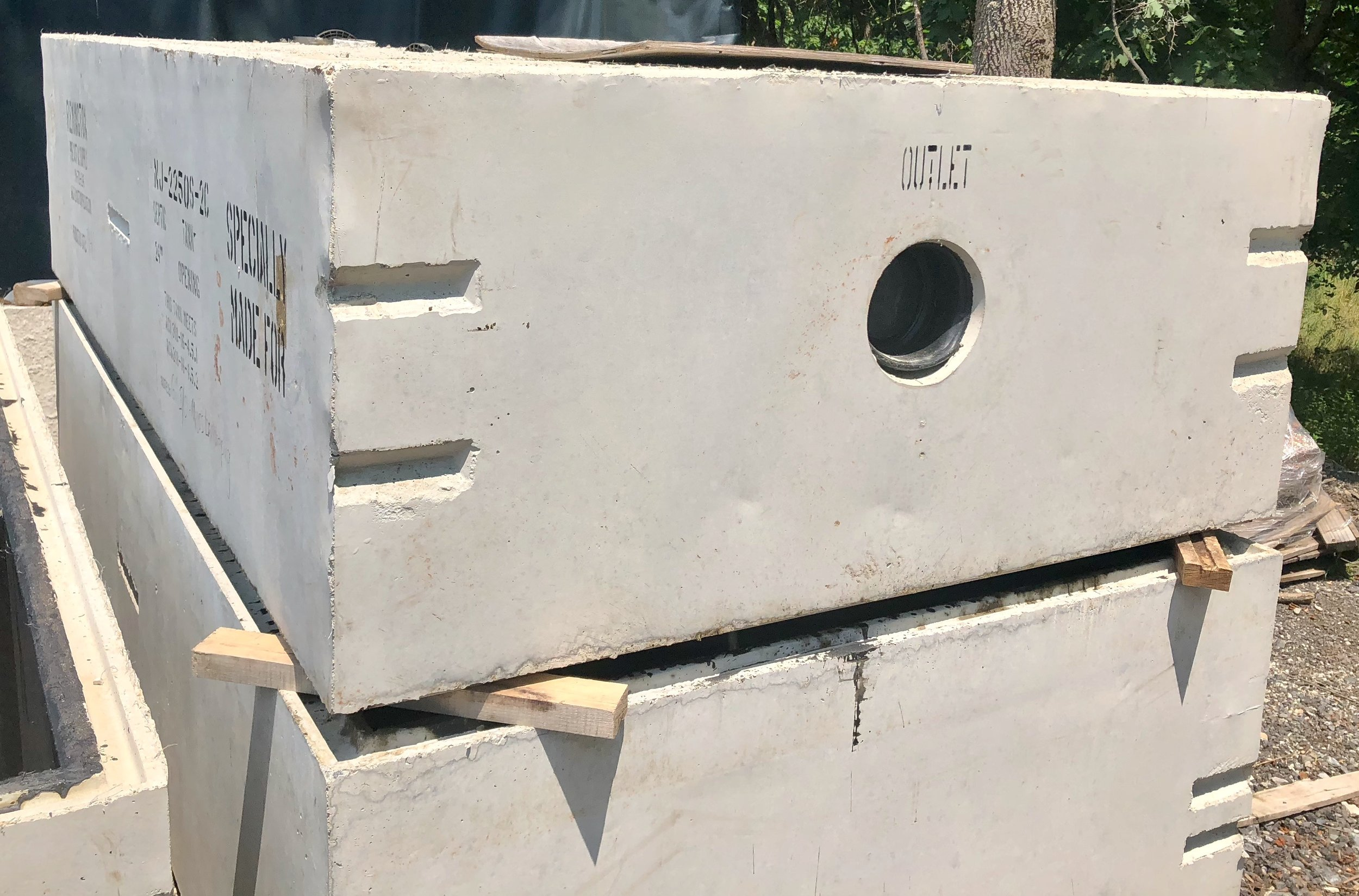 """A custom Two-Compartment Septic Tank with modified boots to accept 6"""" Inlet/Outlet Piping."""