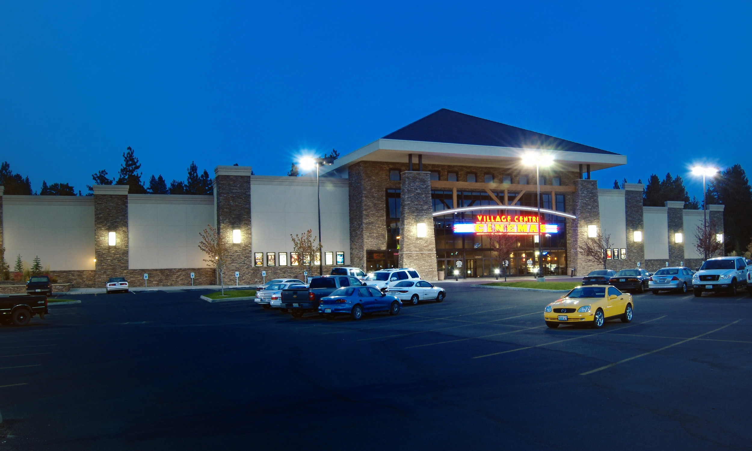 Owner: Corporate Pointe Developers Location: Spokane, WA   This facility added a 14-screen multiplex to the growing number of Village Center Cinemas in Spokane, WA. The structural shell and demising walls between the theaters were constructed using insulated concrete forms, that enhance the theatre acoustics efficiently and economically. Aside from an extensive concessions counter, the lobby also houses a party room and gaming area.