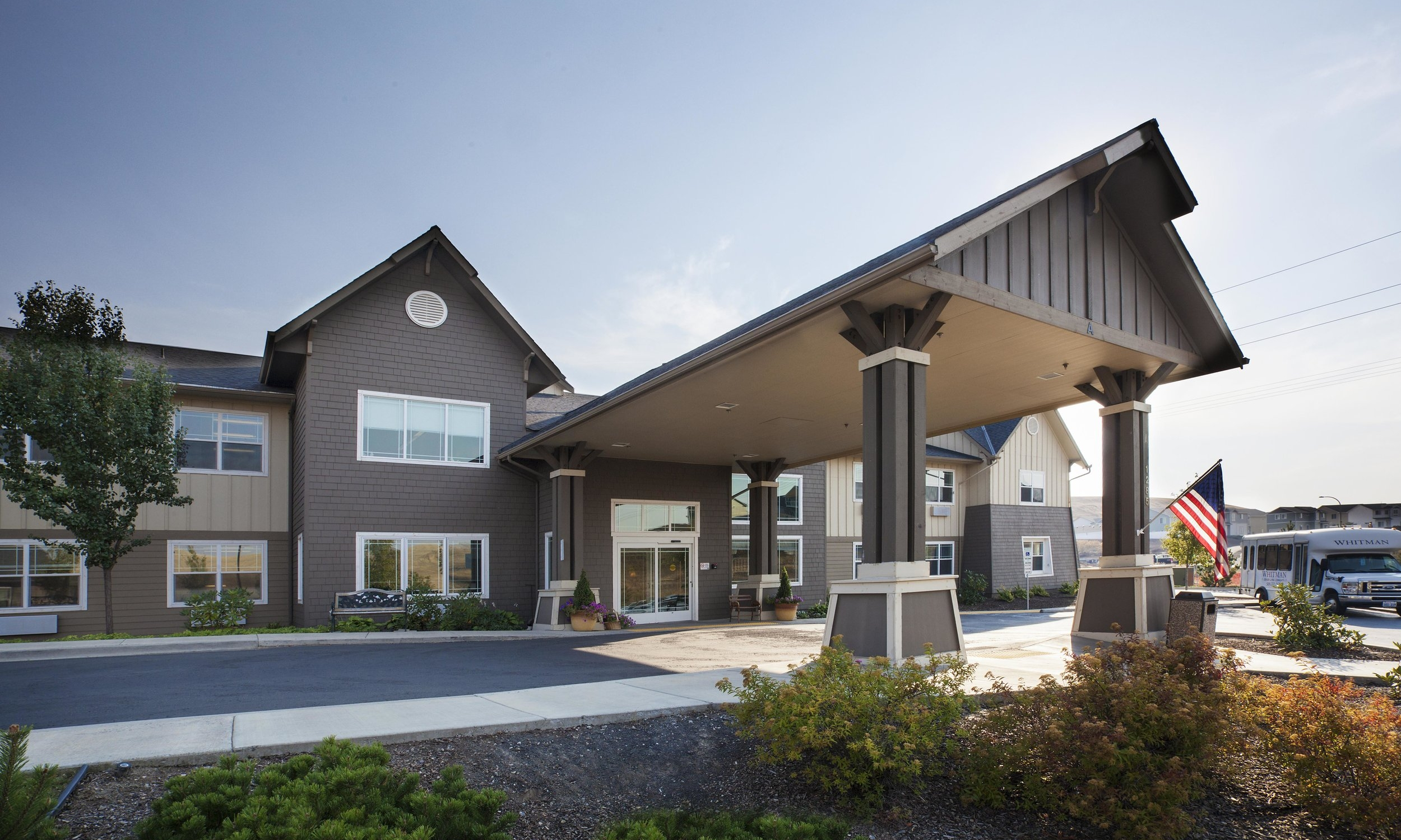 Owner: Pullman Senior Care Operator, LLC Location: Pullman, WA   This assisted living community, set on a site with panoramic views of the rolling Palouse hills and surrounding mountains, is designed to reflect the imagery of its rural Washington context. The design maximizes personal independence and choice and integrated assisted living with its common and support facilities. The campus includes a series of separate cottages and primary building with a central kitchen/ dining area, common areas, library, game rooms, and a nostalgic soda fountain.