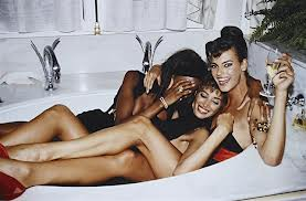 Three models in a bathtub, made famous in 1990.