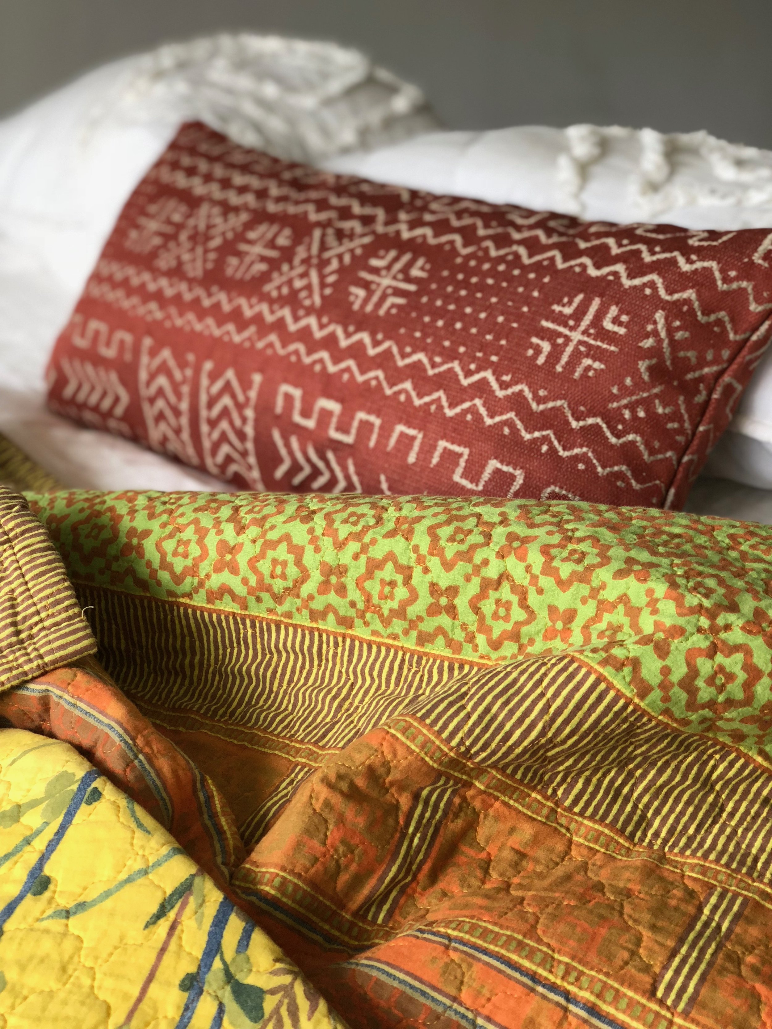 Paprika Arctic Lumbar Pillow - Mudcloth PillowsTrending now, these easy to clean cotton/linen pillows from India and Africa will transform your space with a global aesthetic. We love the way these transitional pillows fit both traditional and modern homes, making your decor pop!