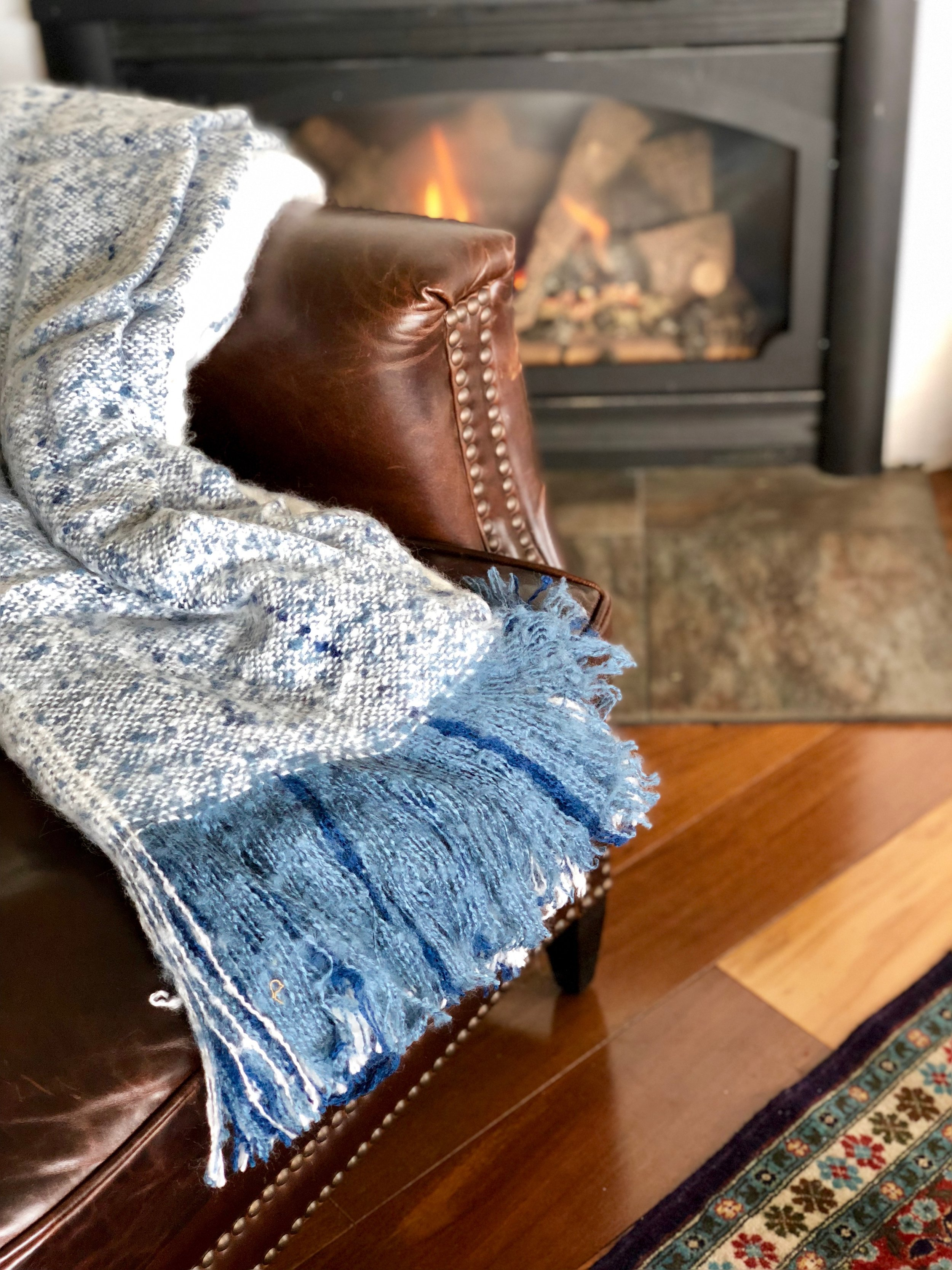 Blue Ombre Blanket - If a blanket falls in a forest, does it still scream your name? With this irresistible knit, the answer is 'yes'! Not just for snuggling anymore, throw this on the end of a bed, chair or sofa for an added layer of texture, color and warmth in any room.