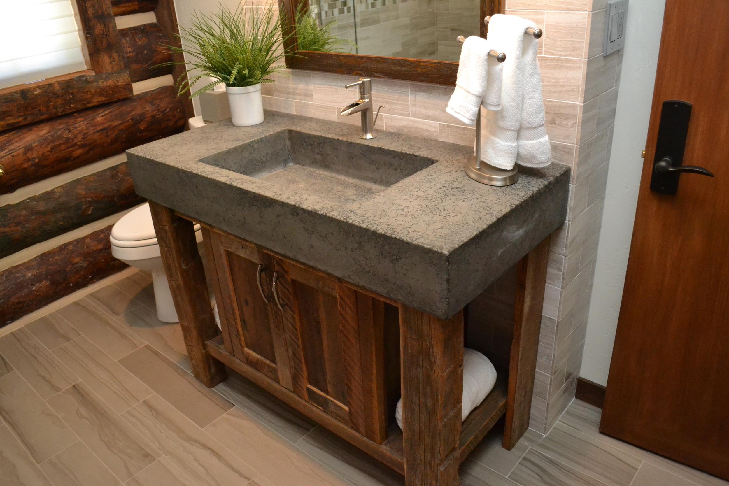 Custom concrete vessel sink in log home