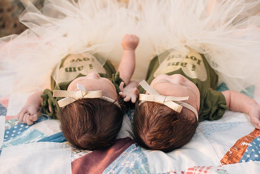 photo of twin newborn girls taken from above