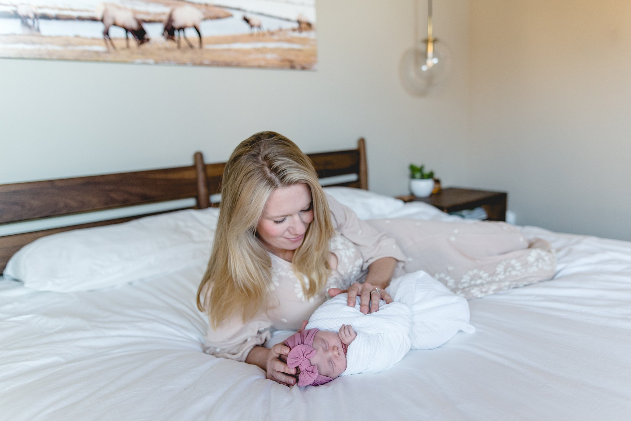 mother and her baby girl lay on the bed