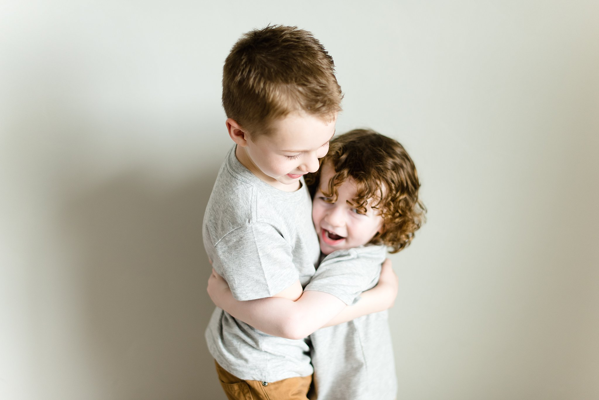 brothers hug in their bedroom