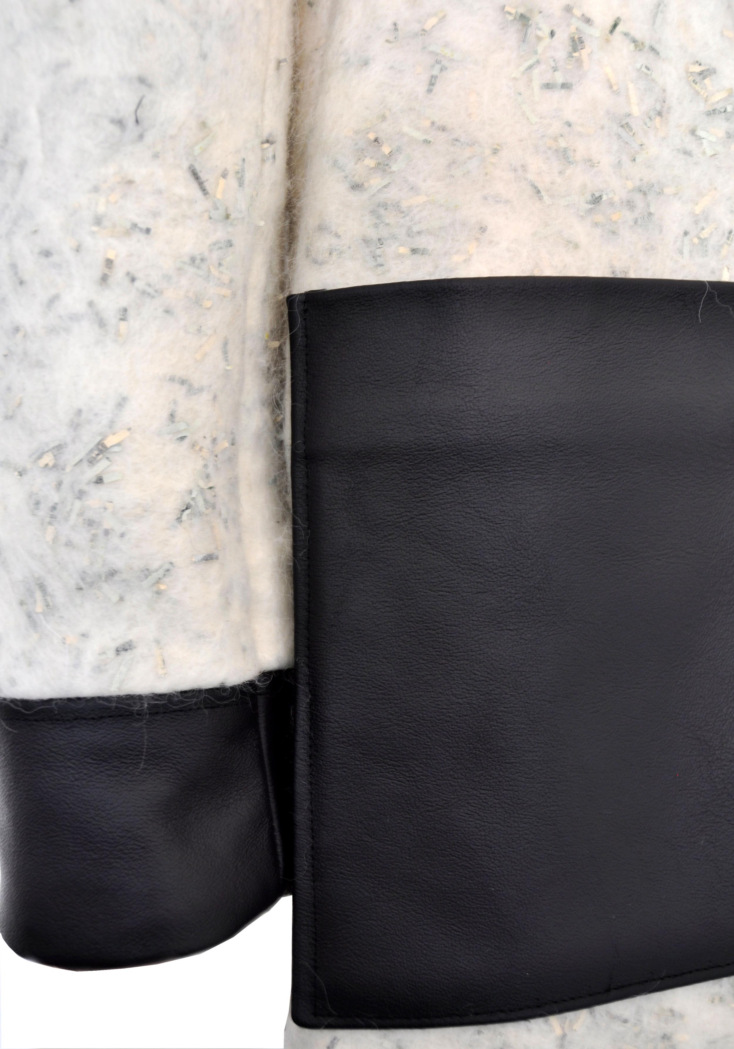 Hooded coat Back-pocket detail.jpg