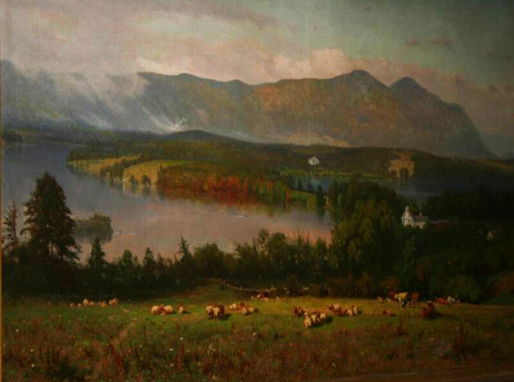 This is a photo of a painting located for viewing in Town Hall.  It is a pastoral view of the Twin Lakes area in Salisbury called Taconic.