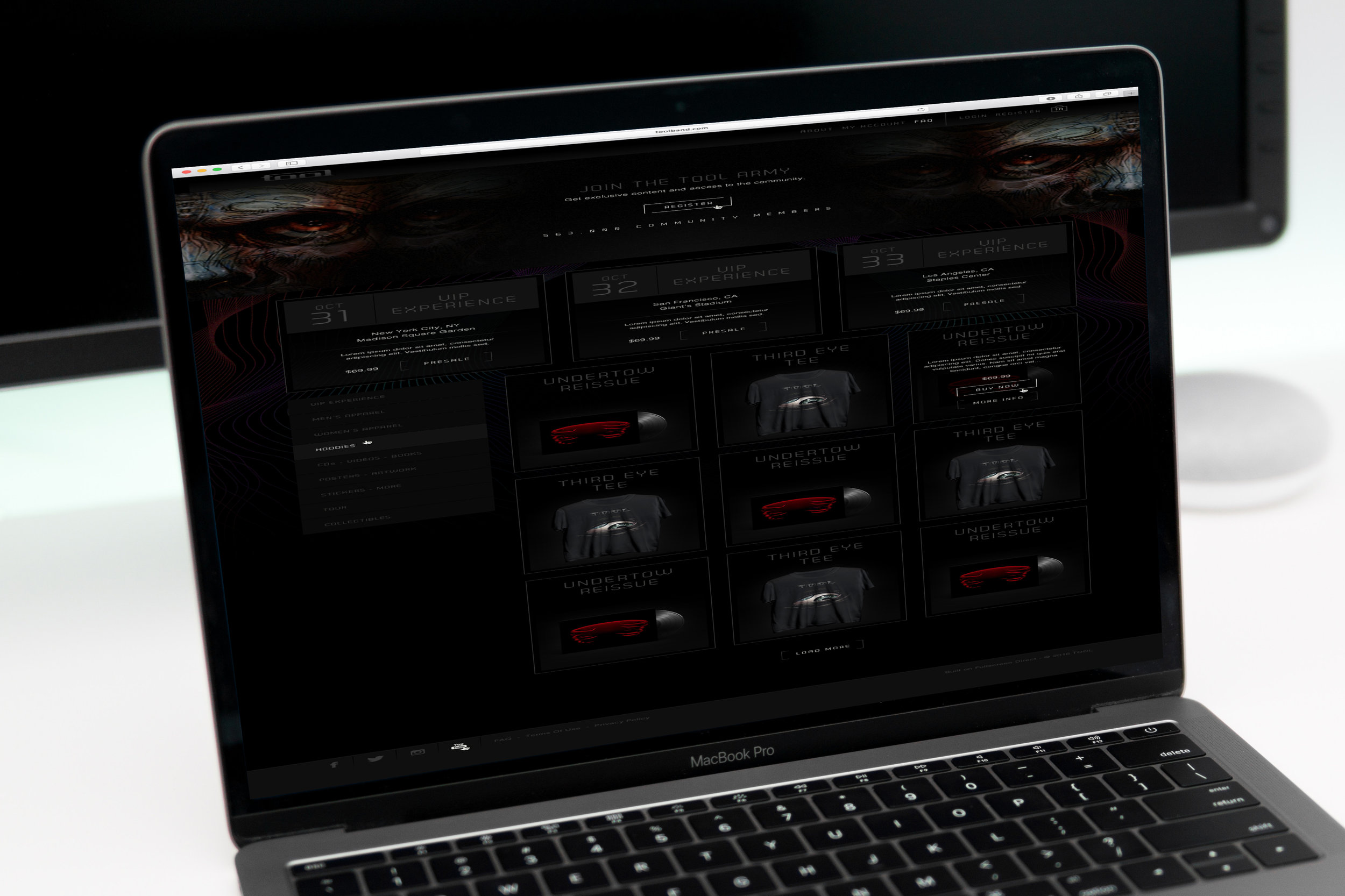 Tool close-view-of-macbook-pro-on-white-desk.jpg