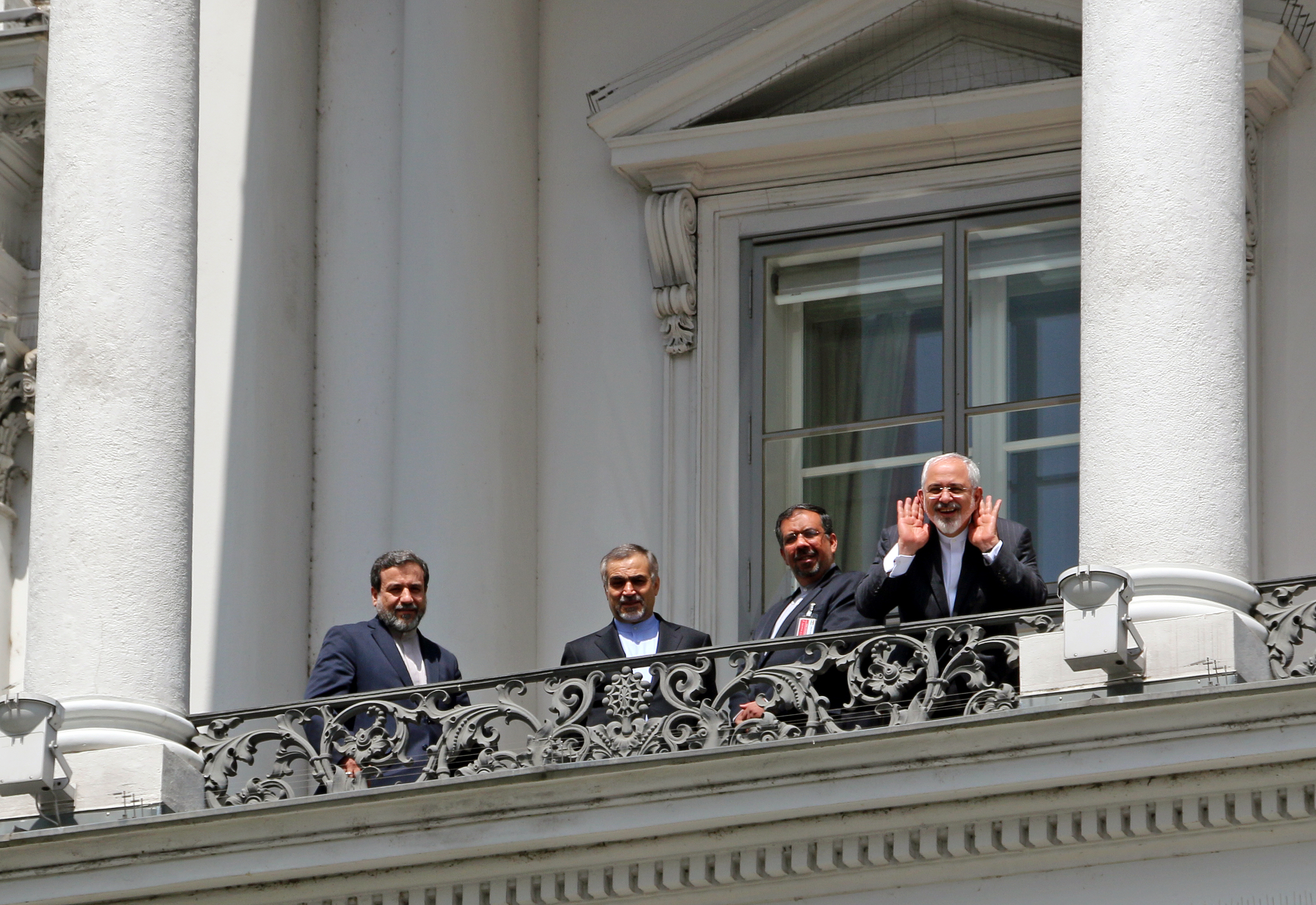 Iranian Foreign Minister Mohammad Javad Zarif and his team meet on a balcony of the Palais Coburg -- Vienna, Austria