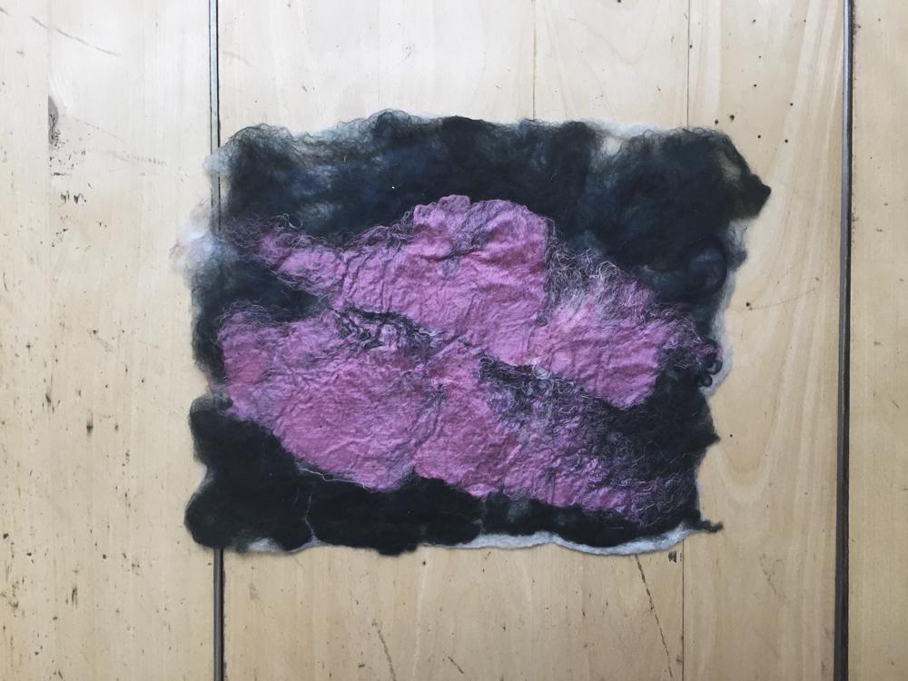 Foreground: pink silk Background: dark green + dark blue wool.