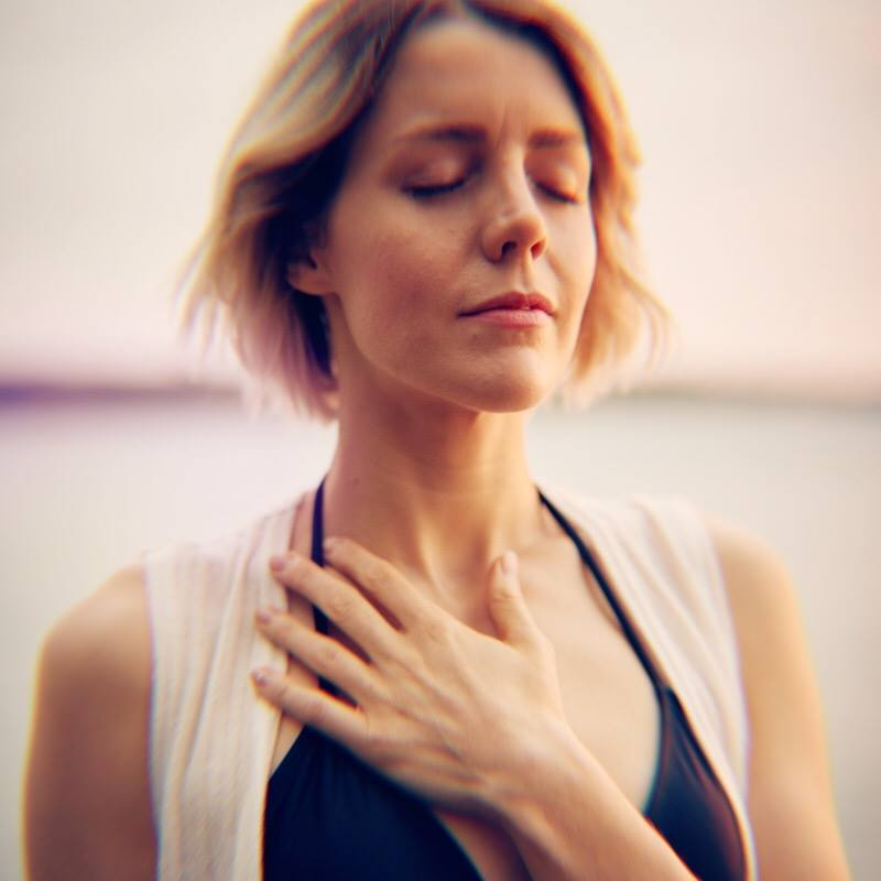 Woman Hand Heart Closed Eyes.jpg