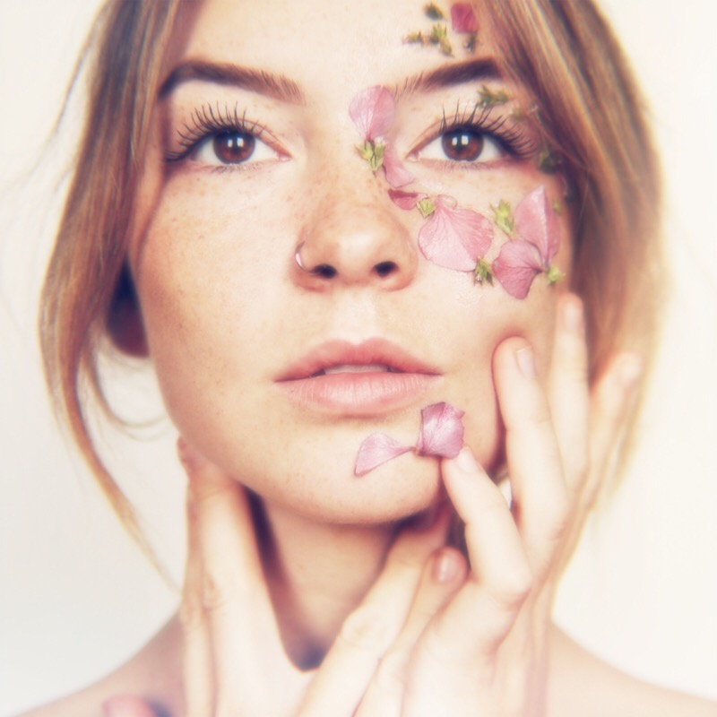 Visionary Woman with Flower Petals on Face.jpg