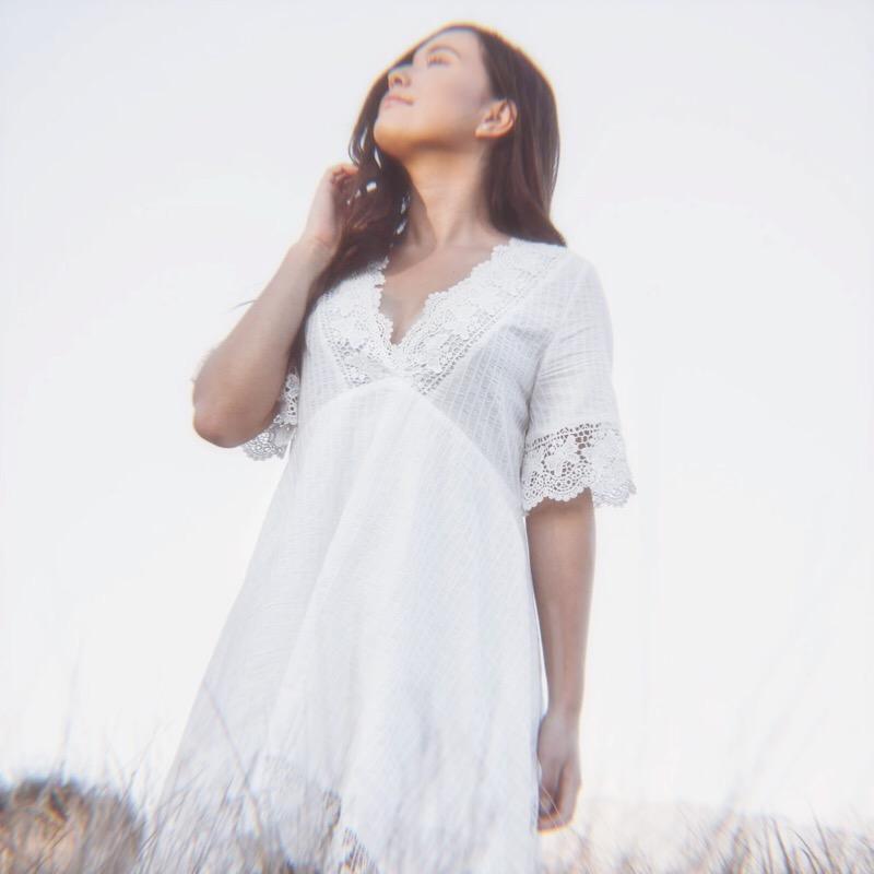 Woman Looking Up White Dress Field.jpg