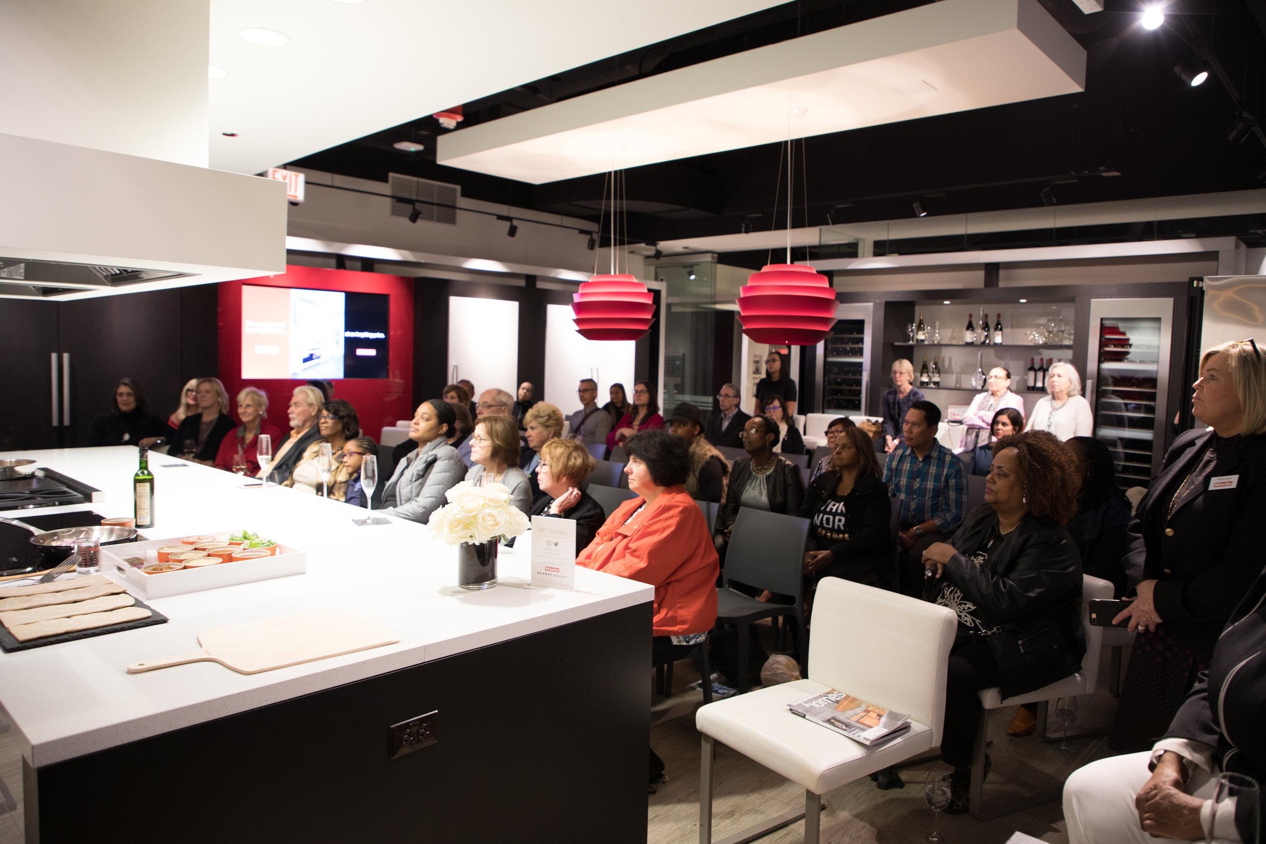 The audience enjoying Ohara Davies-Gaetano's cooking demonstration