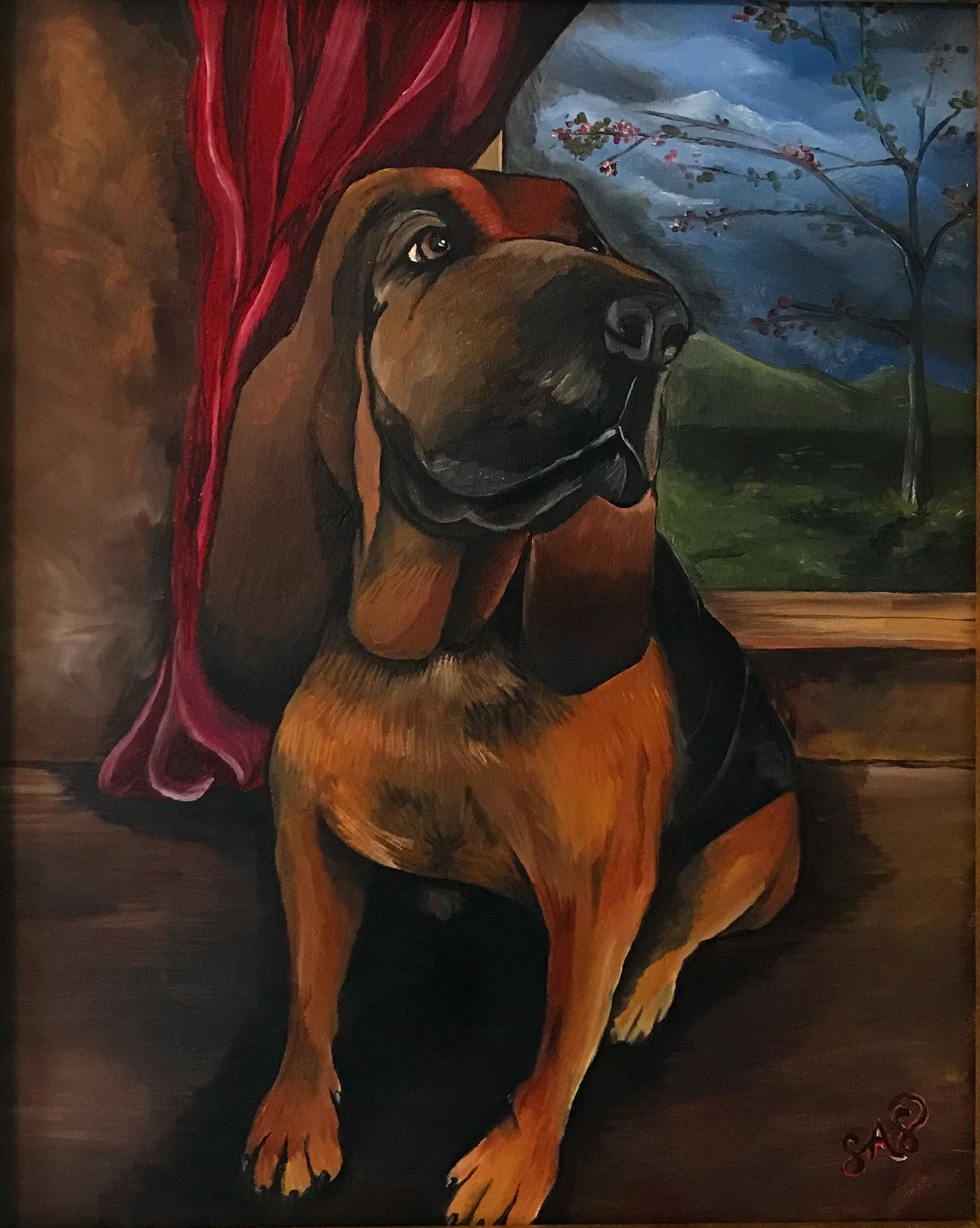 Tallulah the Bloodhound sitting proudly with her portrait.