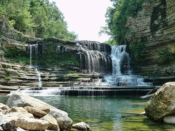 """Shrug off your responsibilities and make a splash at Cummins Falls. The locals swear it's """"Tennessee's best swimming hole"""". Unaltered by man, the gorge is a true natural beauty and holds TN's eight largest waterfall.    (Photograph Via: Kelly Stewart)"""