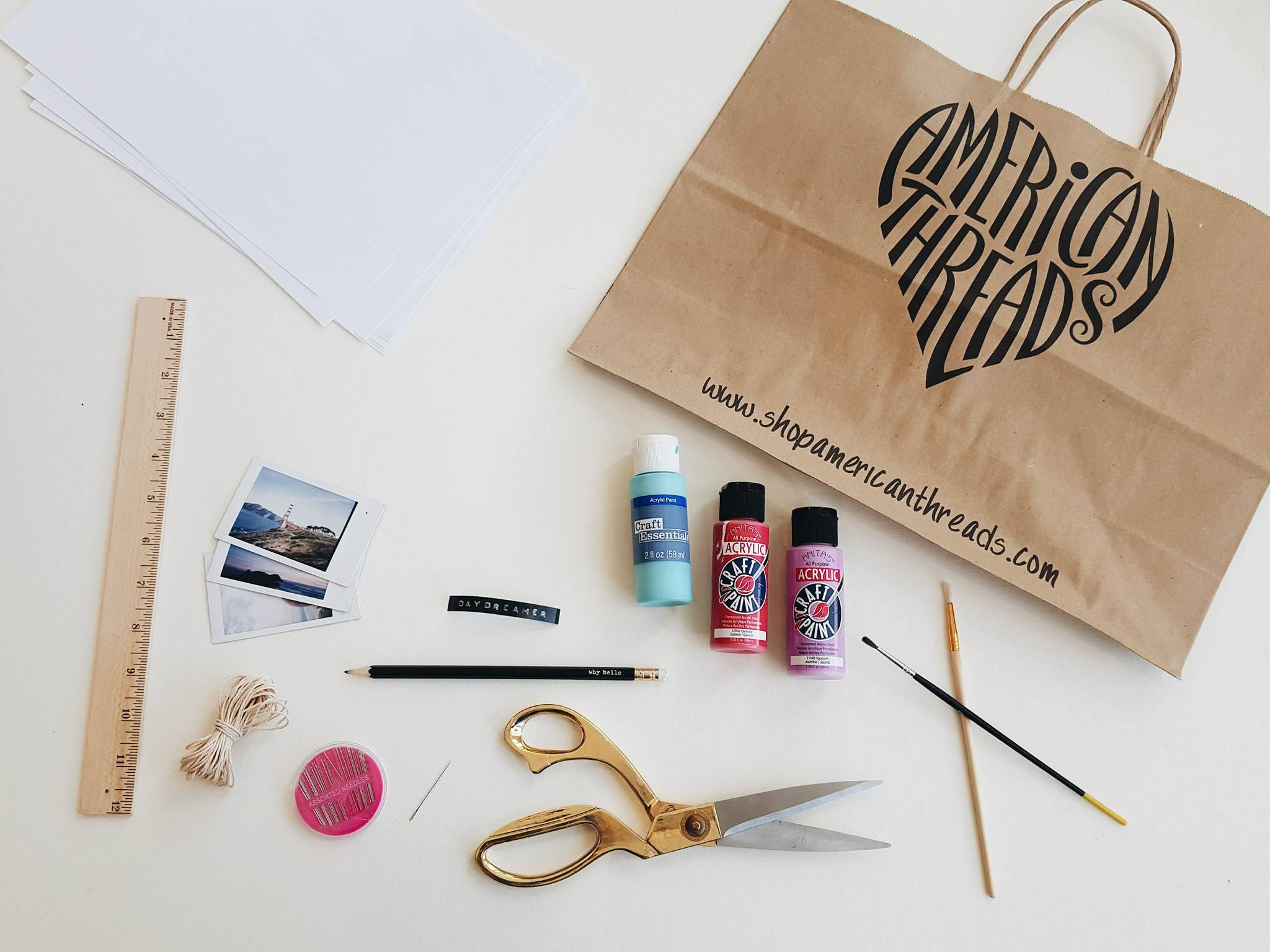 SUPPLIES:  -Recycled Brown Shopping Bag   -White Office Paper   -Scissors  -Ruler   Needle & String   -Pencil   -Paint   -Paint Brushes  -Misc Collage Items (photos, tickets, labels, flowers, magazine scraps, etc)