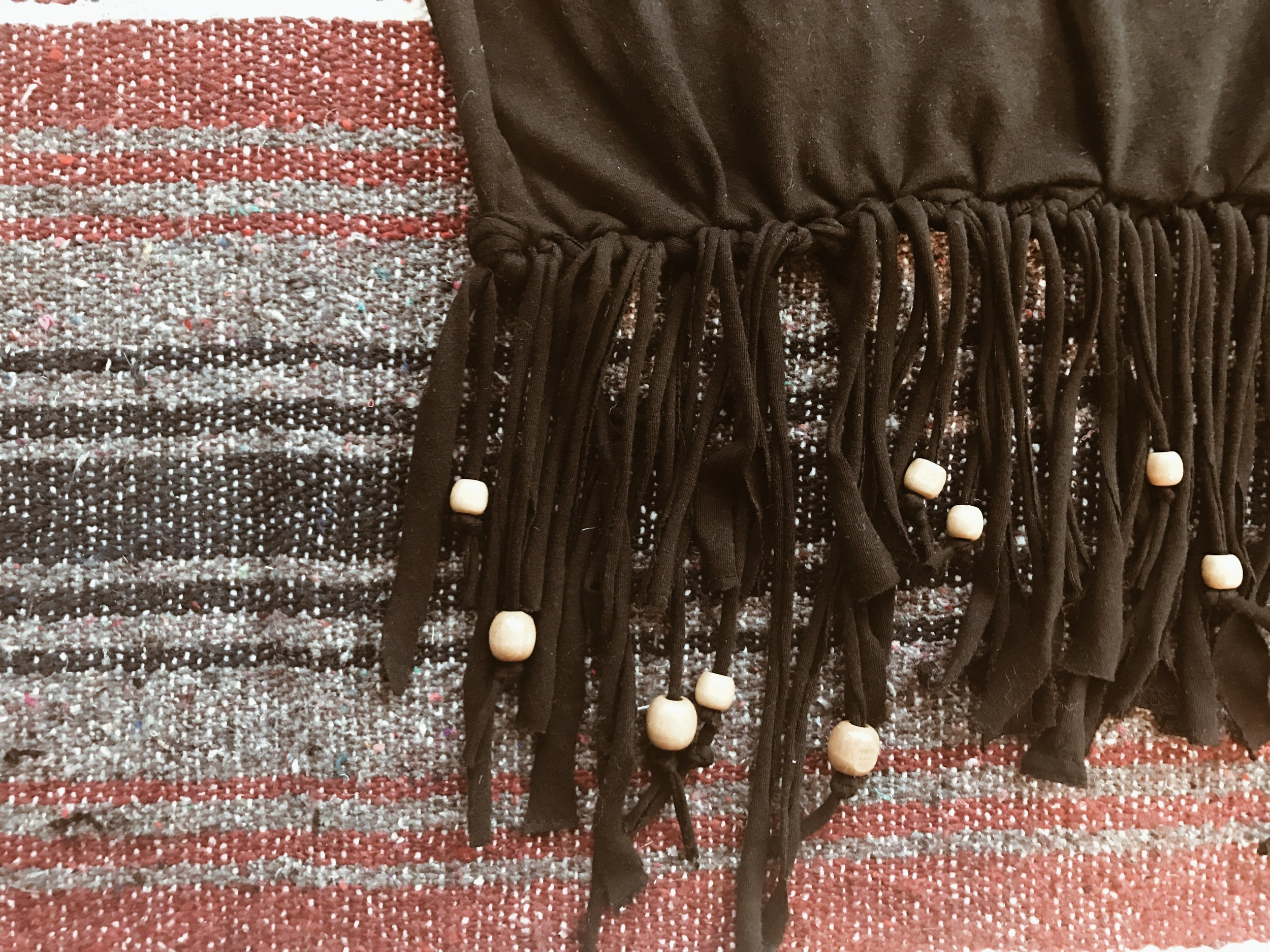 Embellish your bag by adding beads to the bottom fringe! Wooden beads are my favorite, but you can use any kind! Simply slip them on, and tie a knot at the bottom of the strip so the bead stays on!