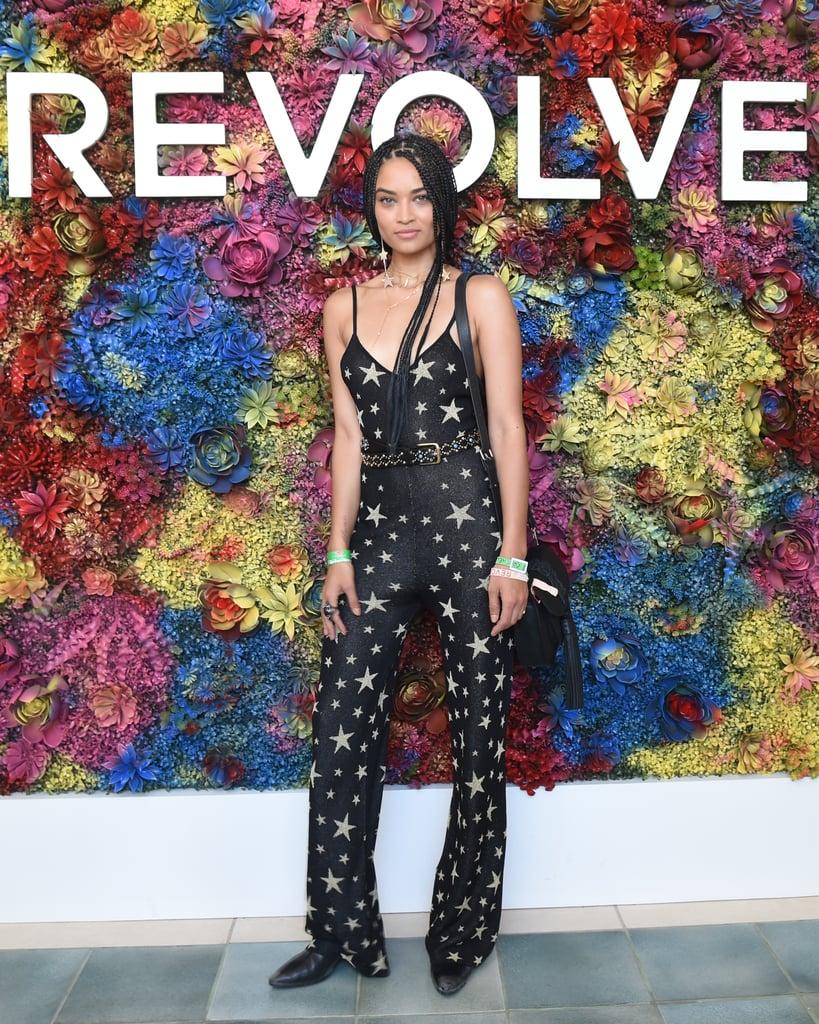 Shanina-Shaik-wearing-star-printed-jumpsuit-Revolve-Festival.jpg