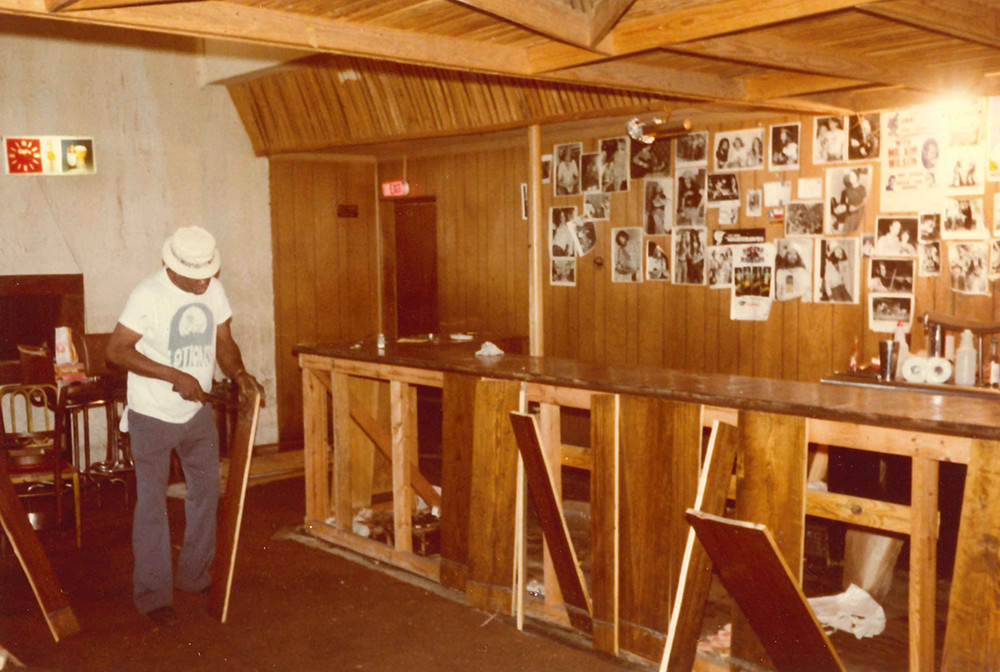 C-Boy taking apart the bar at the Rome Inn after its final night in 1980.
