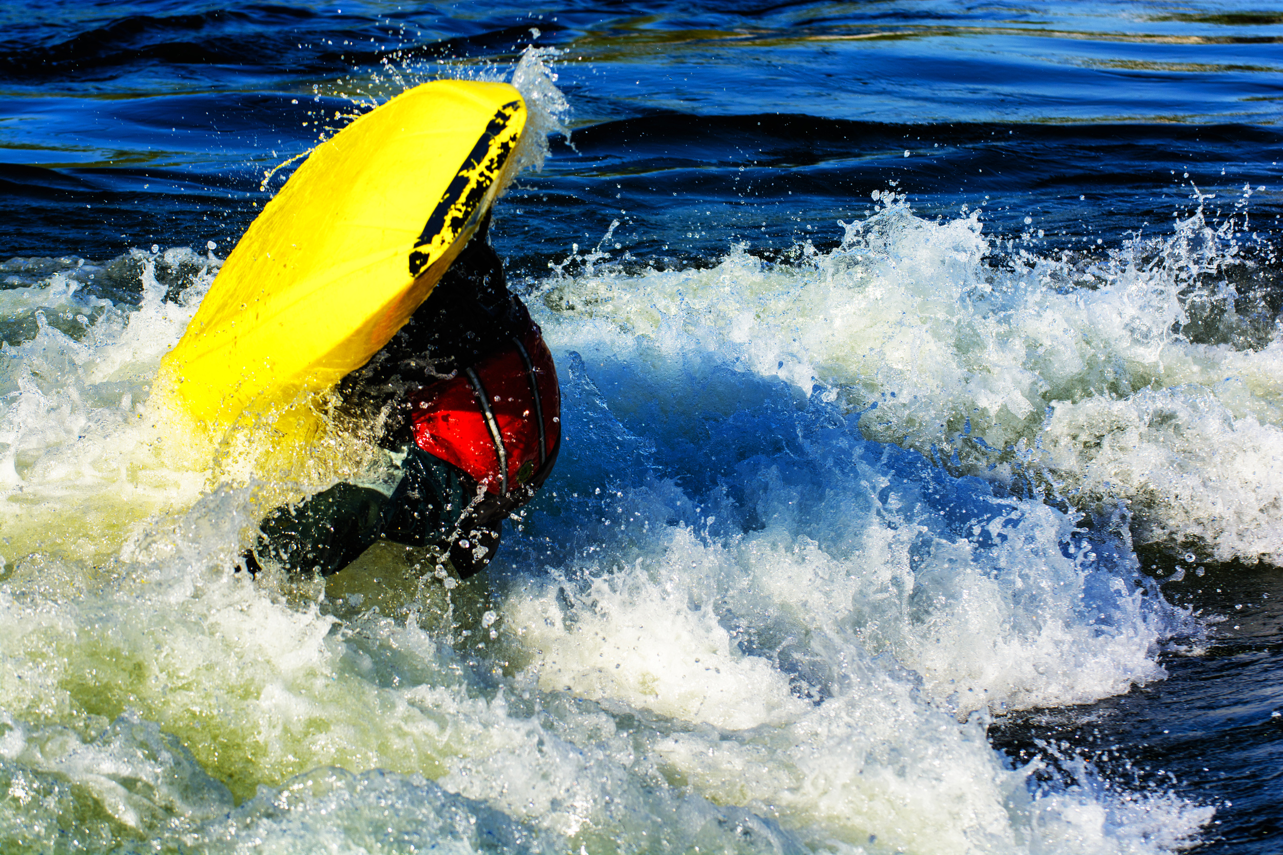 """6/29: Boise Whitewater River Park, super cool feature right in downtown! This boater is throwing what is known as a """"loop,"""" essentially a forward flip while in a boat, he is mid loop."""