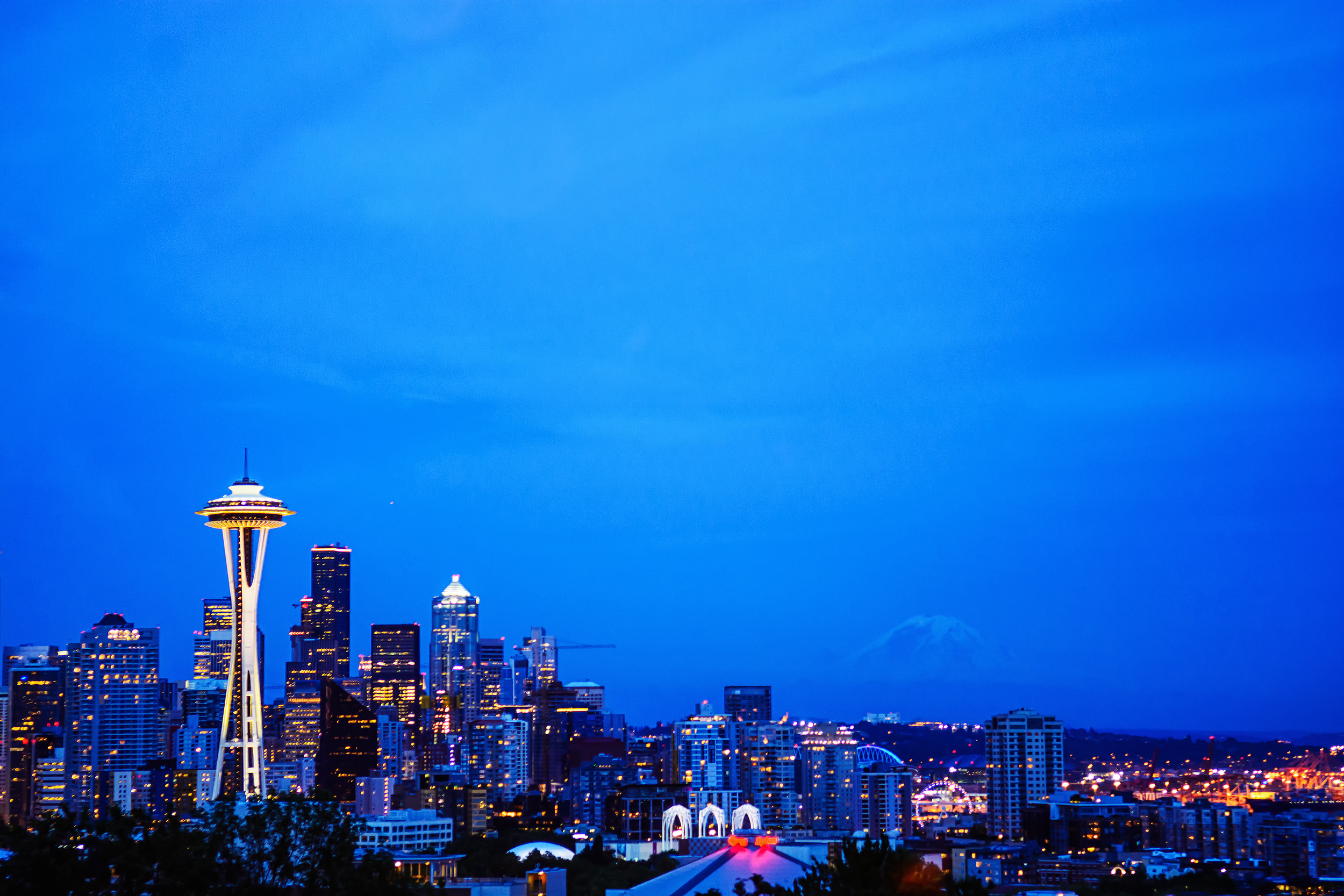 7/7 Photo: Yeah, Seattle is a beautiful Skyline, Mt. Rainer in the background (bucket list to climb that peak)