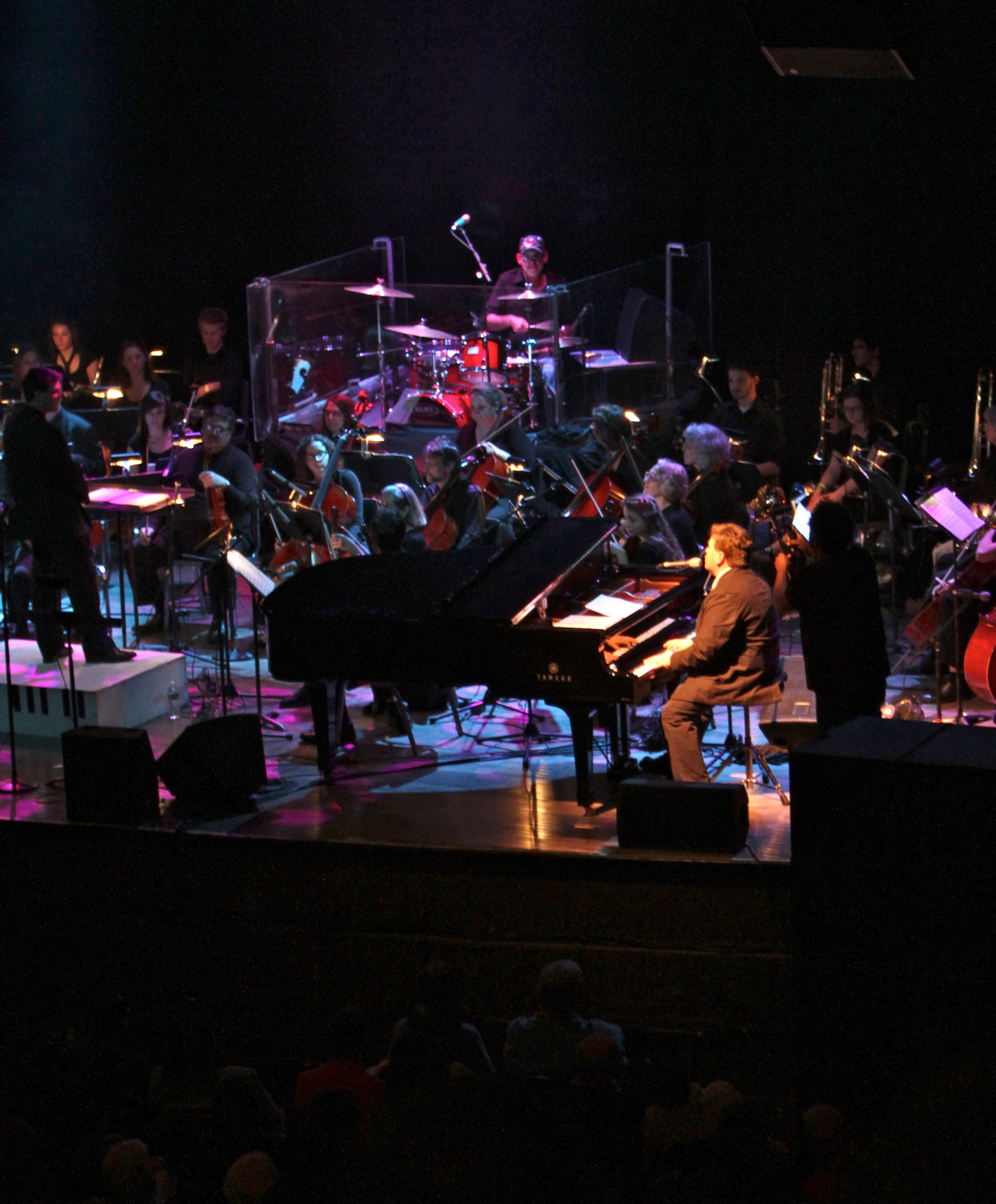 """""""I have found over the years that it takes passion and dedication to be successful in this business we call music. The Southern Maine Symphony Orchestra was just that. A night of """"The Music of Elton and Billy"""" was one of the most passionate performances I have been a part of since actually performing with Billy and Elton together for over ten years. Joe Boucher did an excellent job as both Billy and Elton. Backed by a four piece rhythm section and a fifty two piece orchestra made it an event I was proud to be a part of and am looking forward to doing again!""""        Liberty DeVitto      Billy Joel Band drummer 1976 - 2006"""