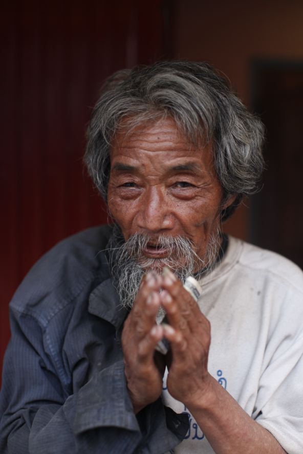 laos_motorcycle_tour_michael_benabib_portrait_photographer_travel.JPG