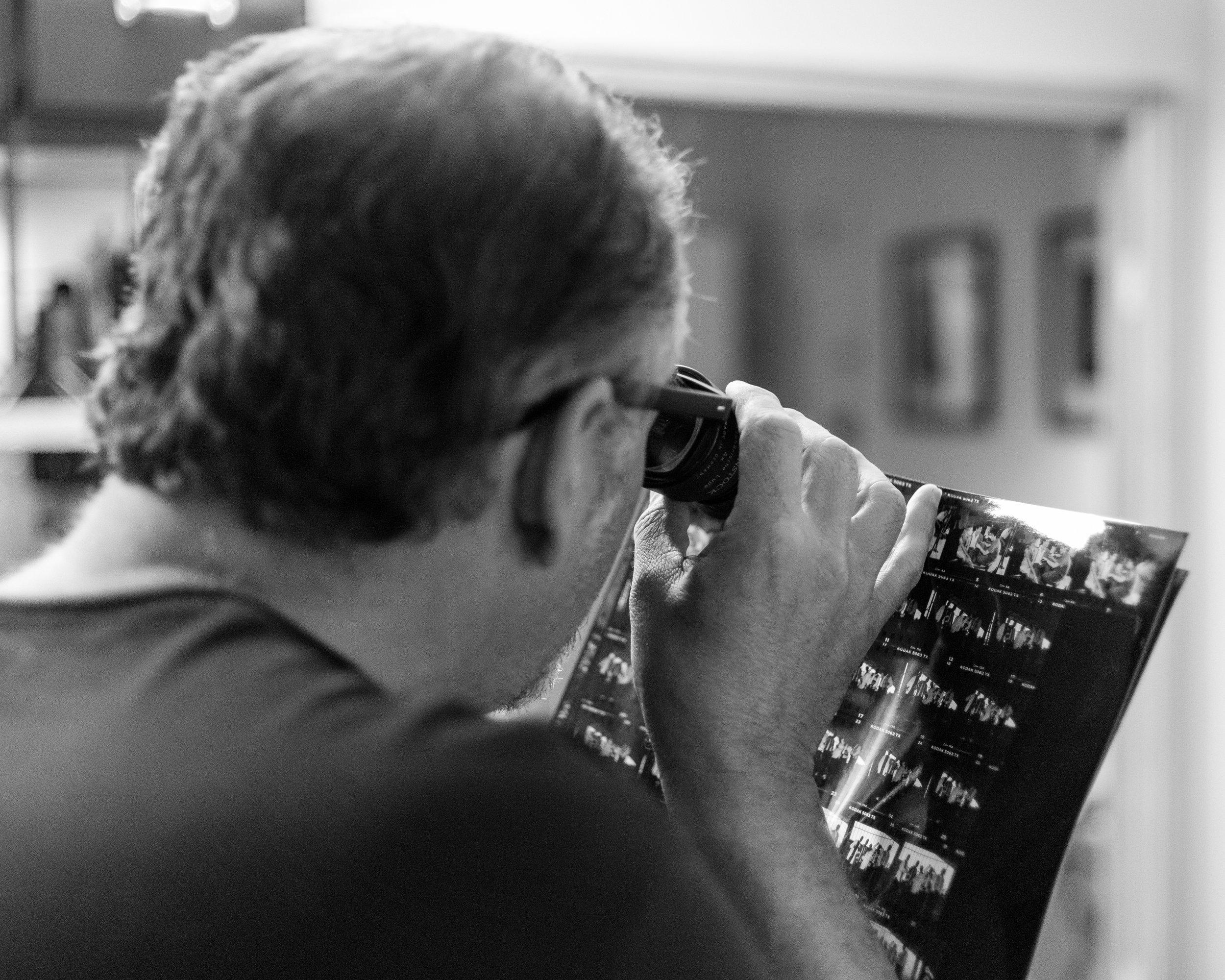 celebrity photographer Michael Benabib viewing photo negatives.JPG