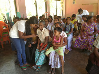 Village coordinator assisting with rapid prototyping during field visit to Maha Oya in NE Sri Lanka