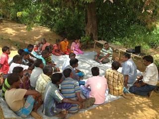 The research team meets with a group of farmers near Vakarai