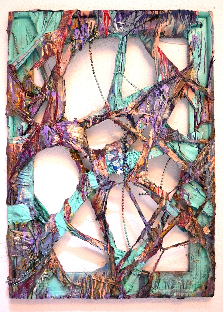 """2013,  Decay   40""""x30"""". Found frame, beads, gold leaf, spray paint, house paint, acrylic paint, house linens, wood scraps."""