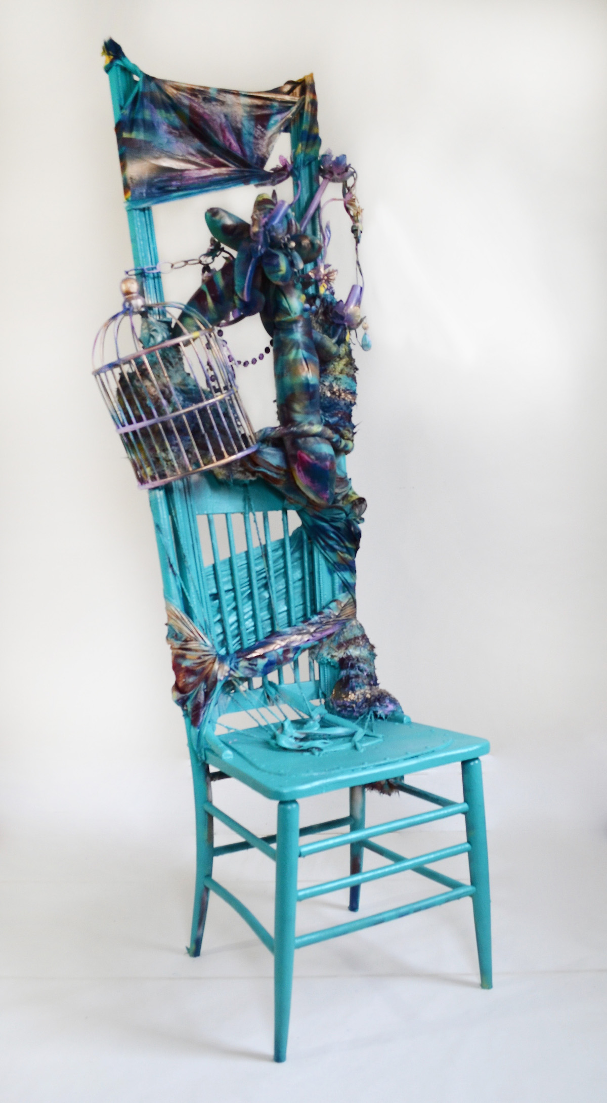 Throne,  2018 6'x2'x2.5', Found chairs, birdcage, chandelier, beads, moulding, furry fabric, spray paint, polyester fiberfill