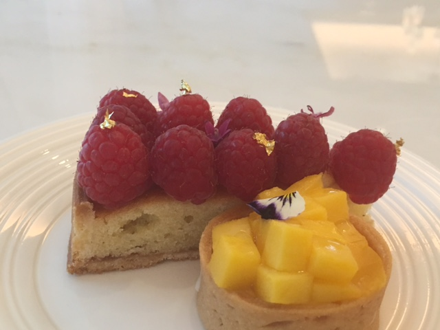 Gilded desserts adorned with flower petals
