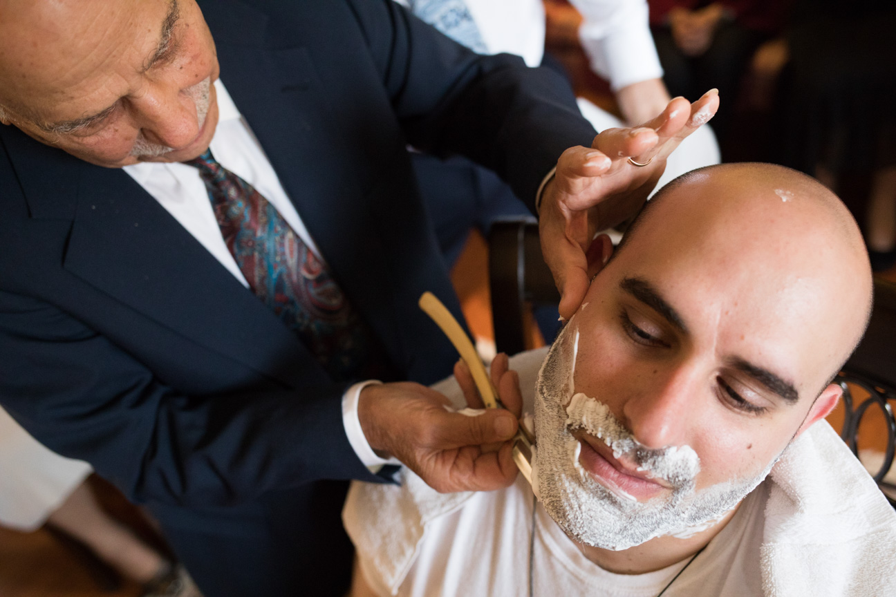Groom's grandfather shaving him