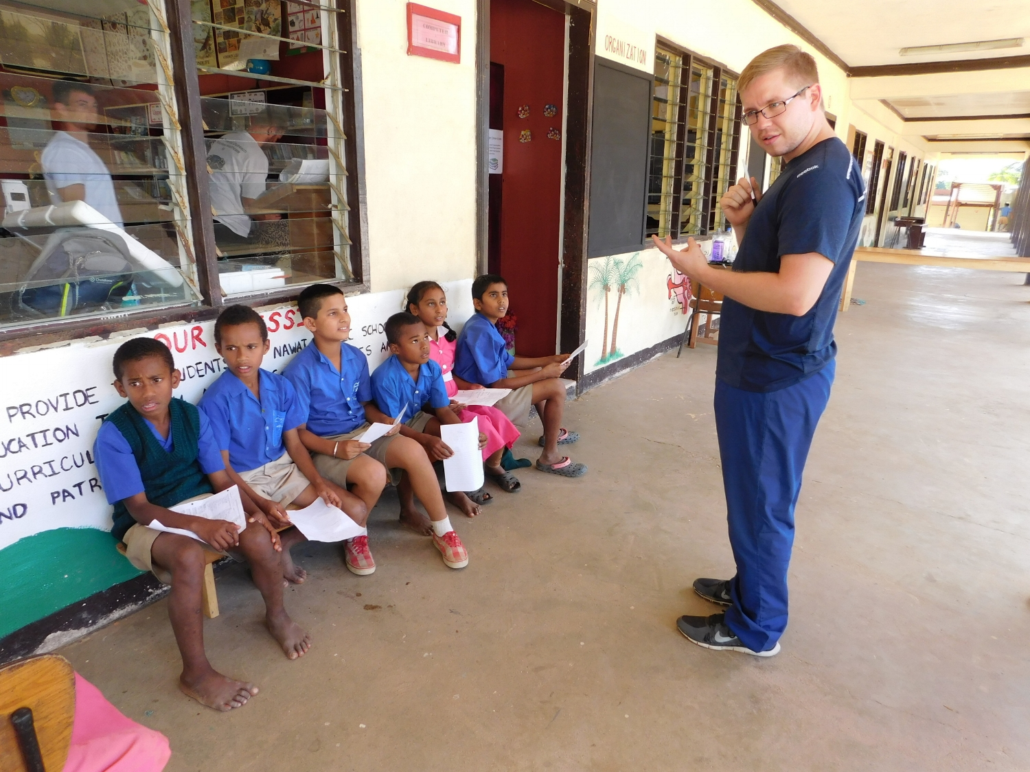 Dr. Alex Wolfe teaching a group of students