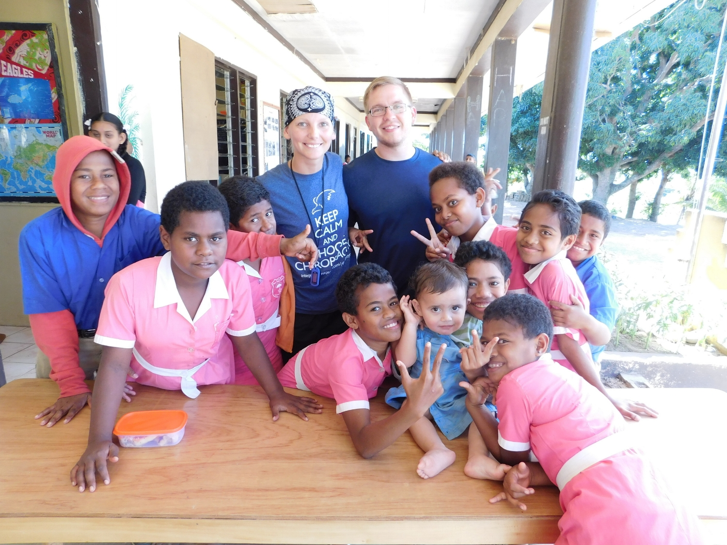 Drs. Hannah and Alex with students on outreach trip