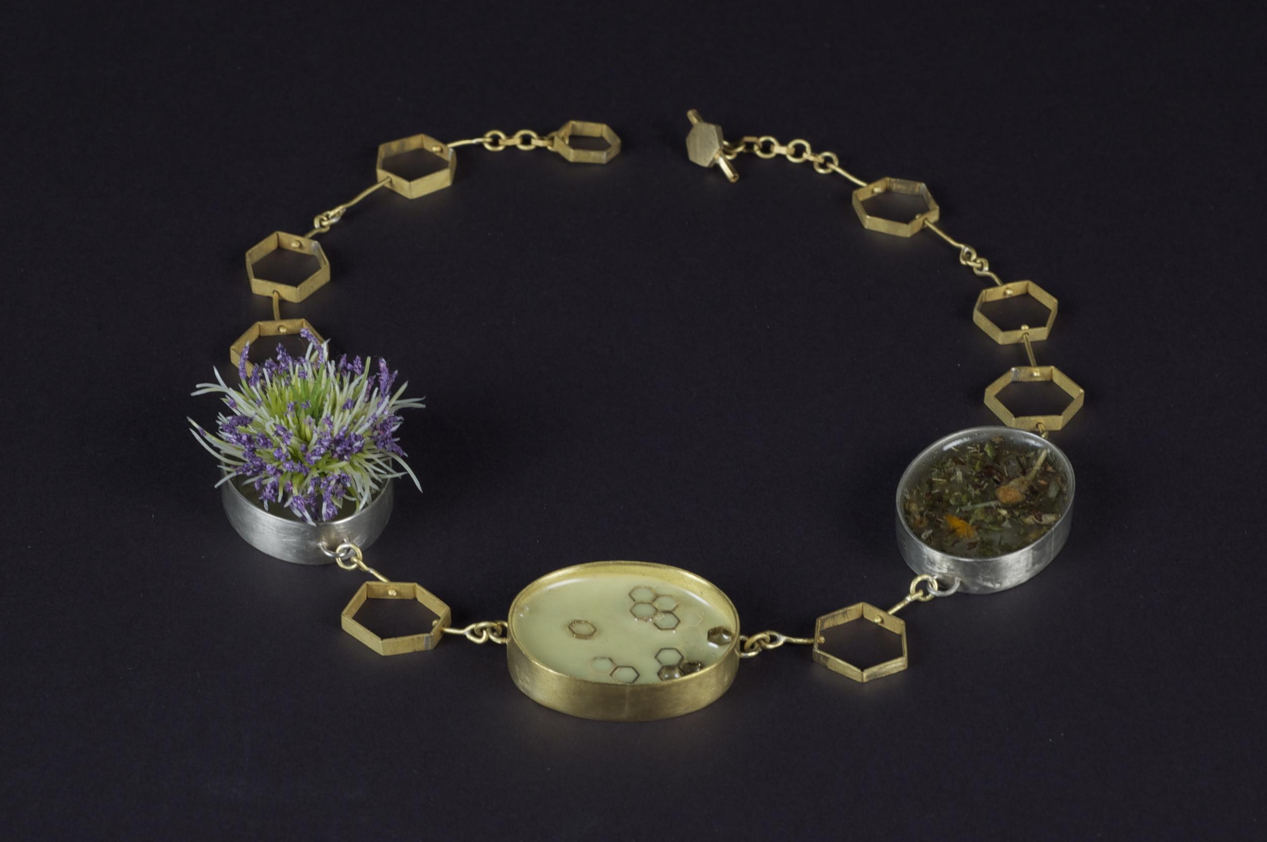 Symbiosis Neckpiece    brass, nickel, resin urethane, dried herbs and flowers, plastic flower