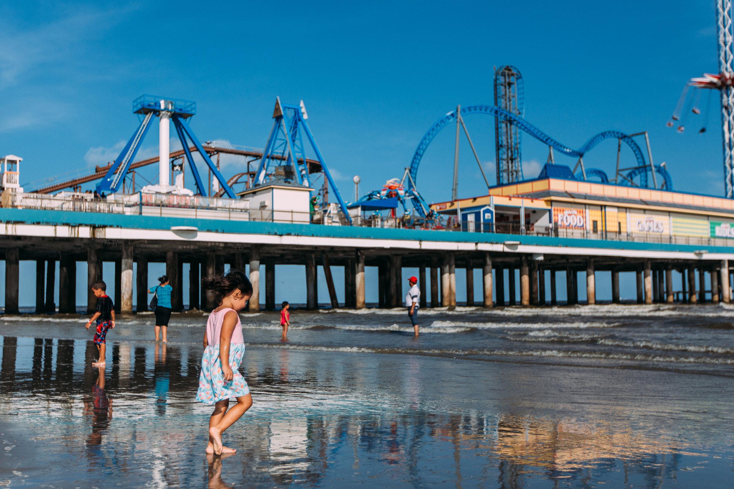 Little girl walking by the pier