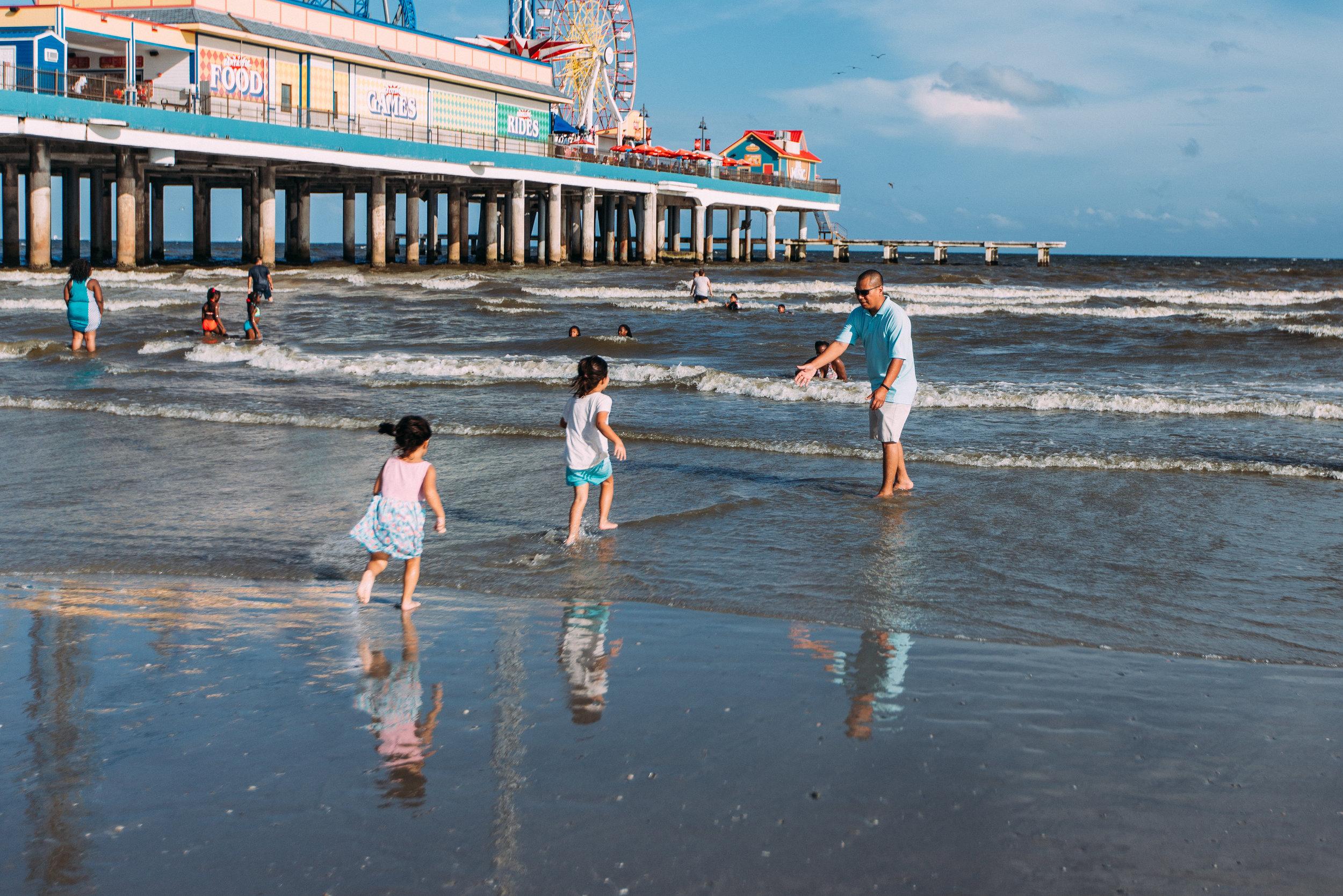 Little girls running to Dad