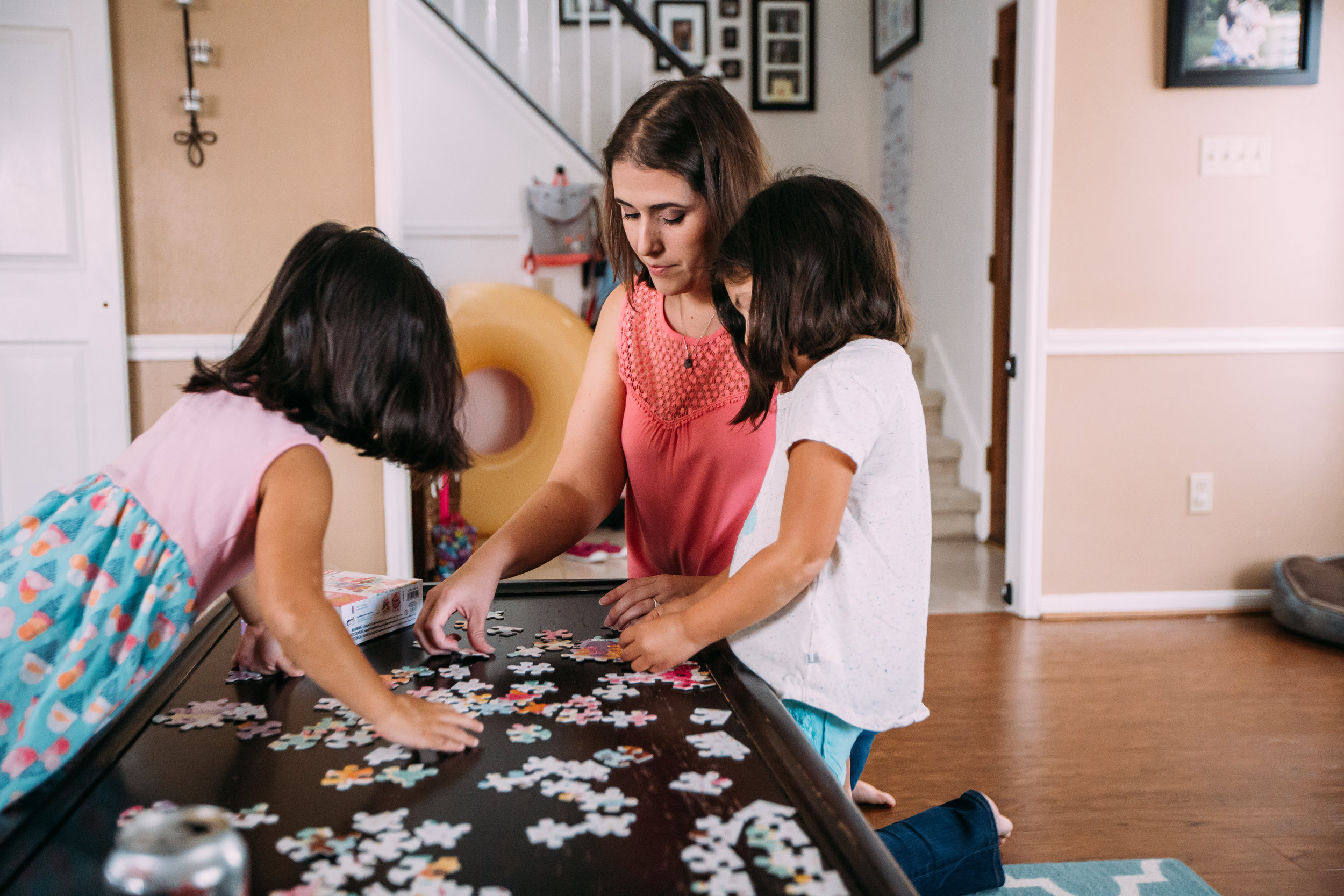 Mother and daughter doing puzzles