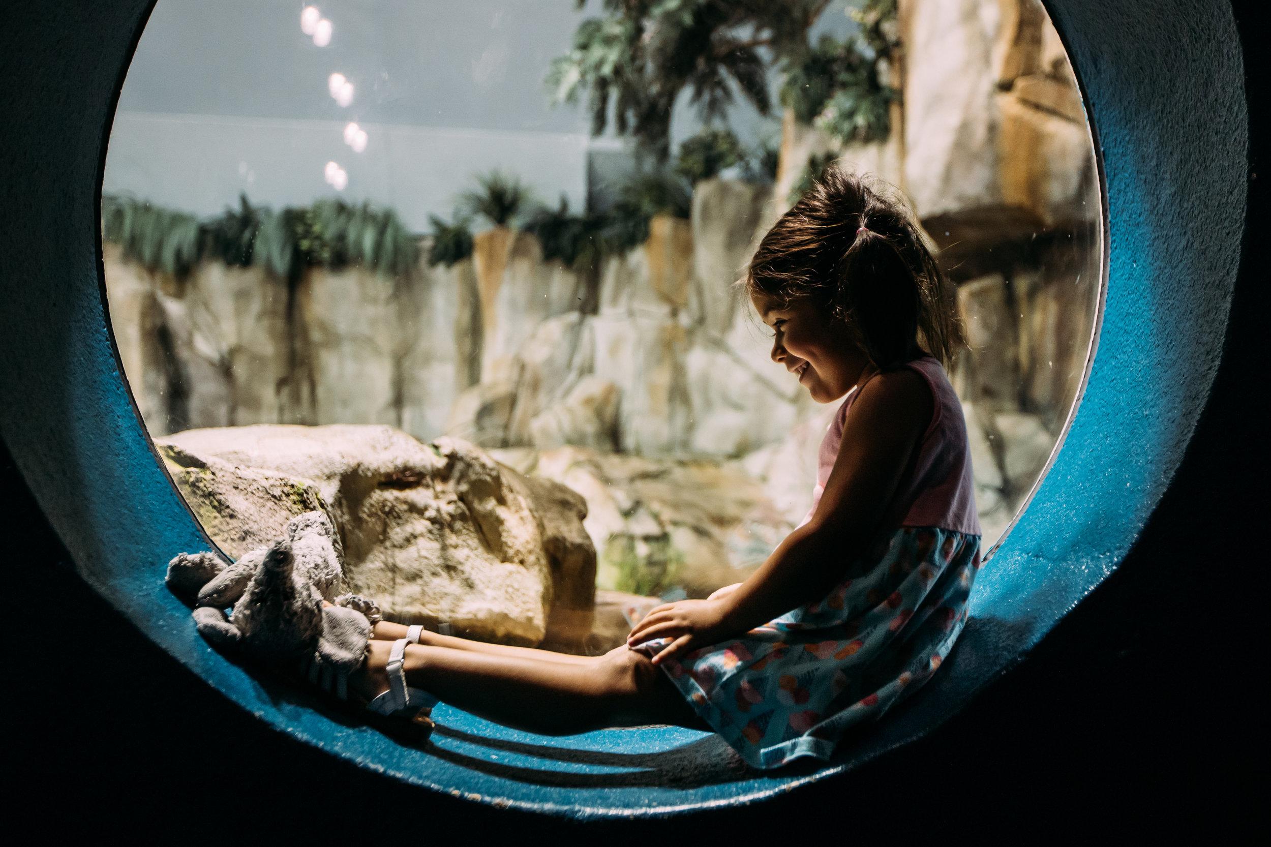 Little girl in circlular window