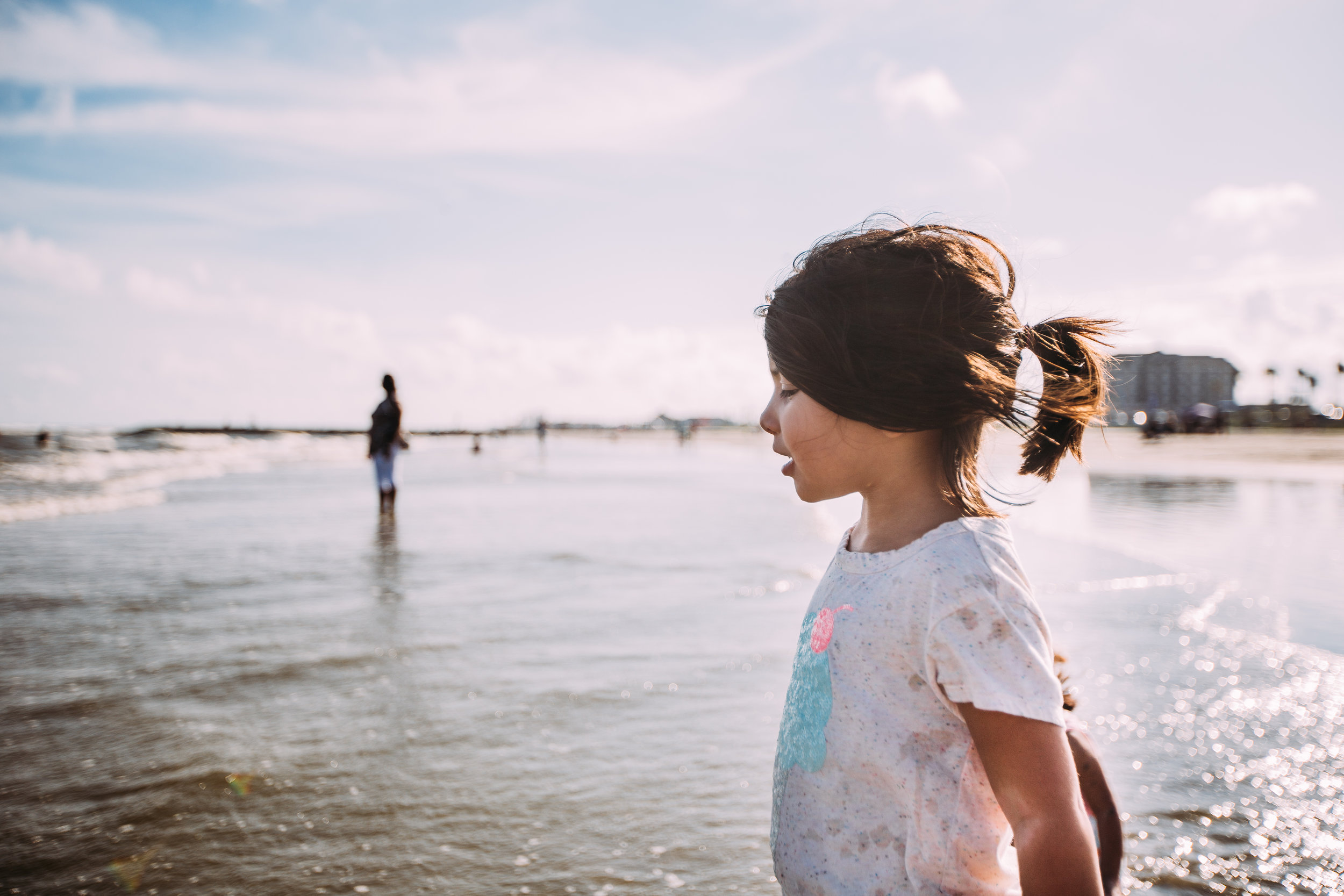 Little girl looking at on the sea