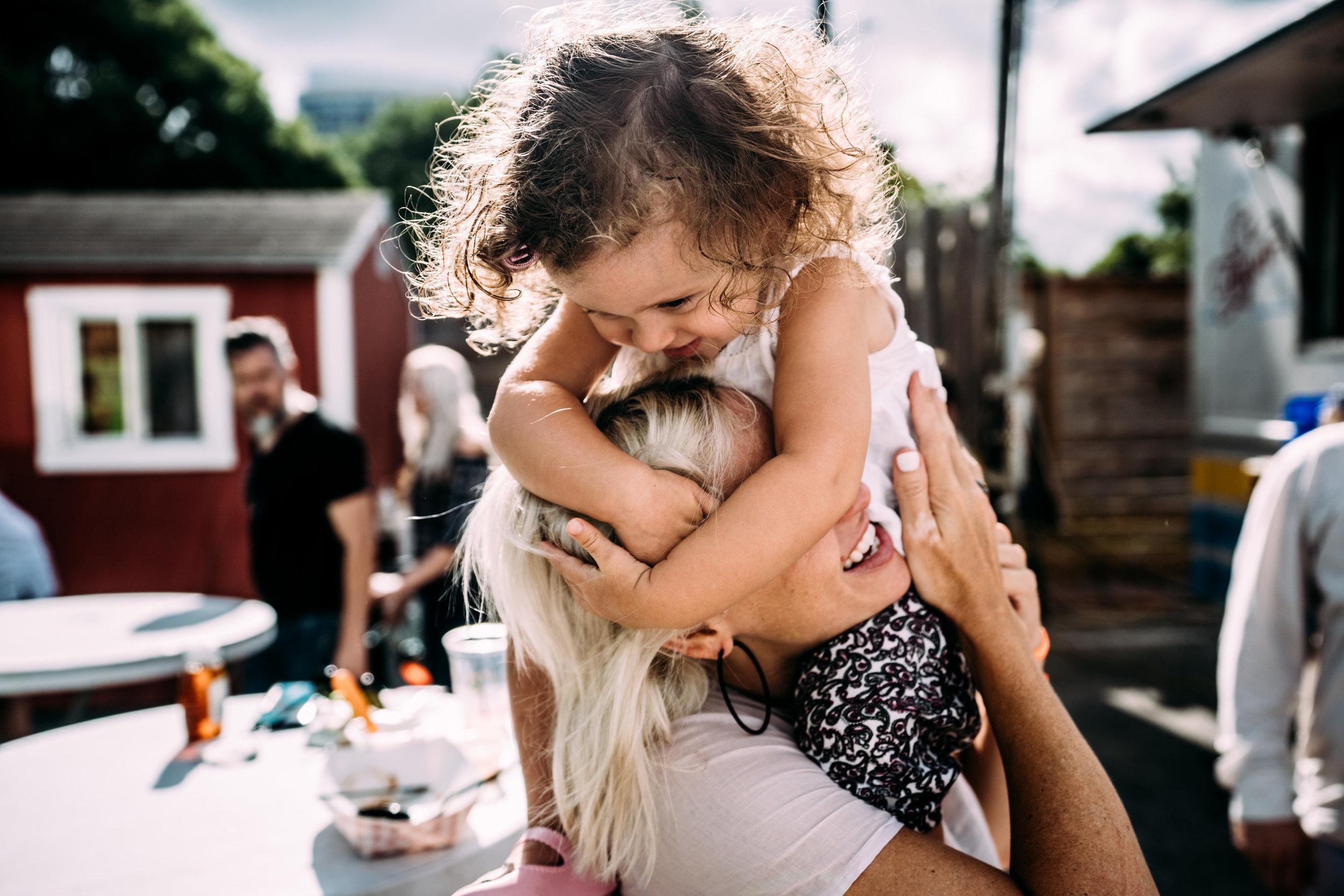 Little girl hugs mom's head