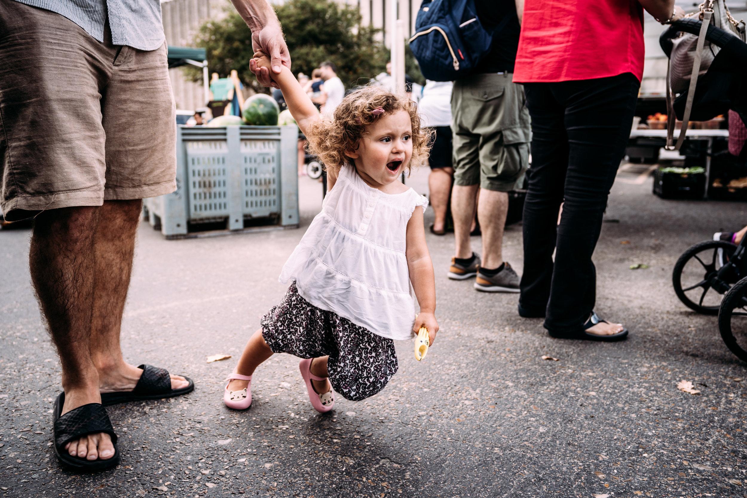 Little girl drags daddy along