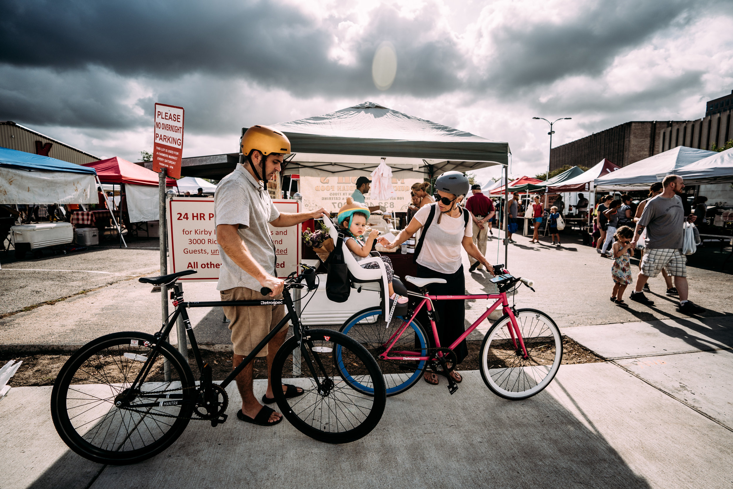 Family getting on bikes after a trip to the farmers market
