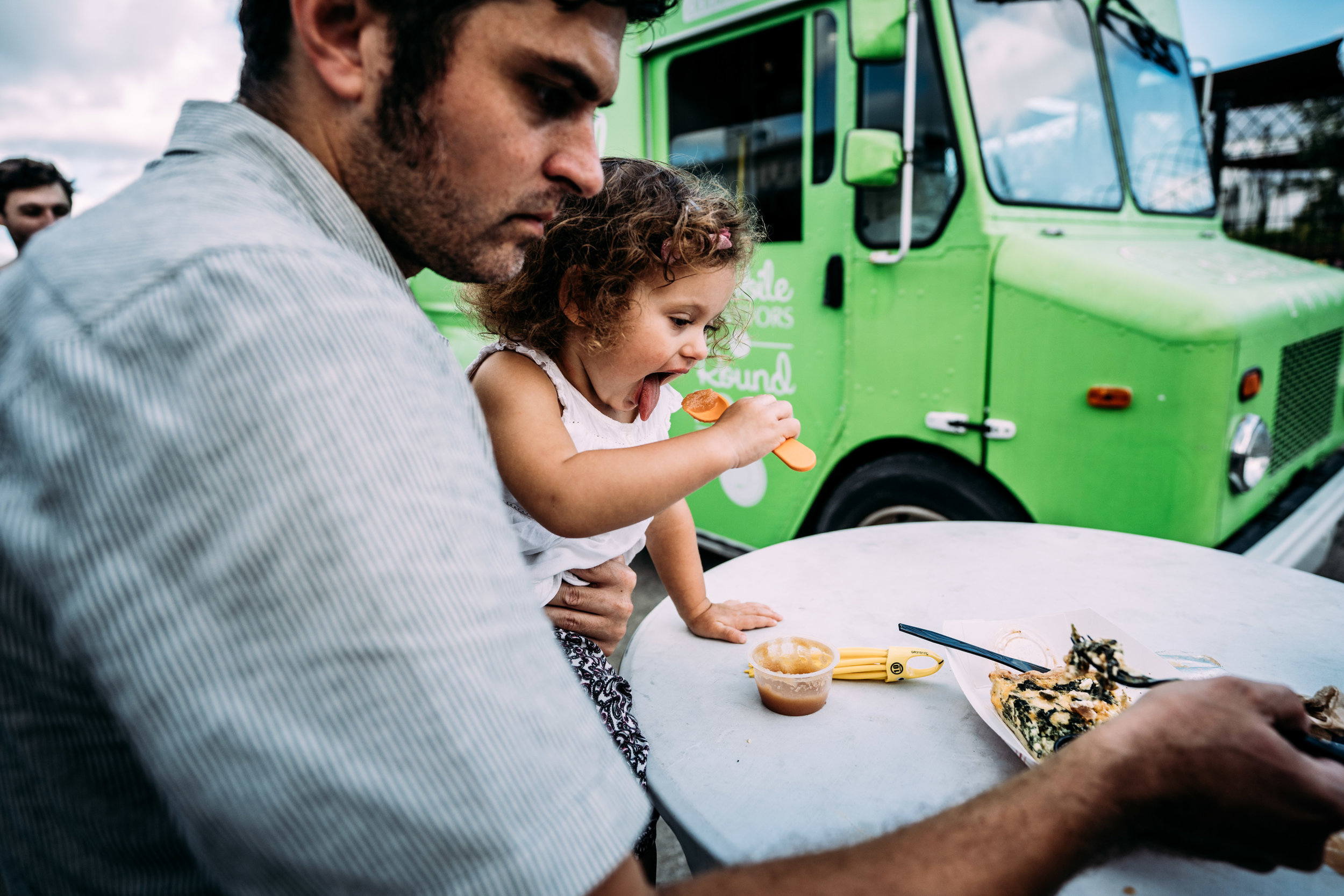 Daddy and daughter eat lunch together